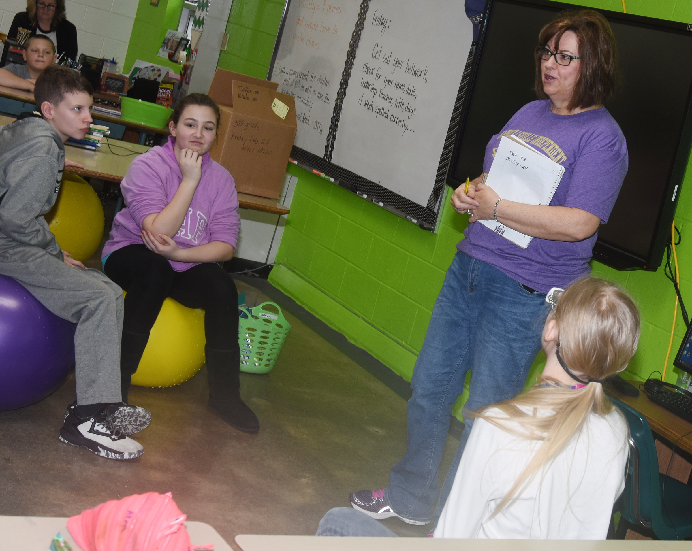 Susan Kennon, a Campbellsville Family Resource and Youth Services Center liaison at CES, talks to fifth-graders about the importance of eating healthy foods.