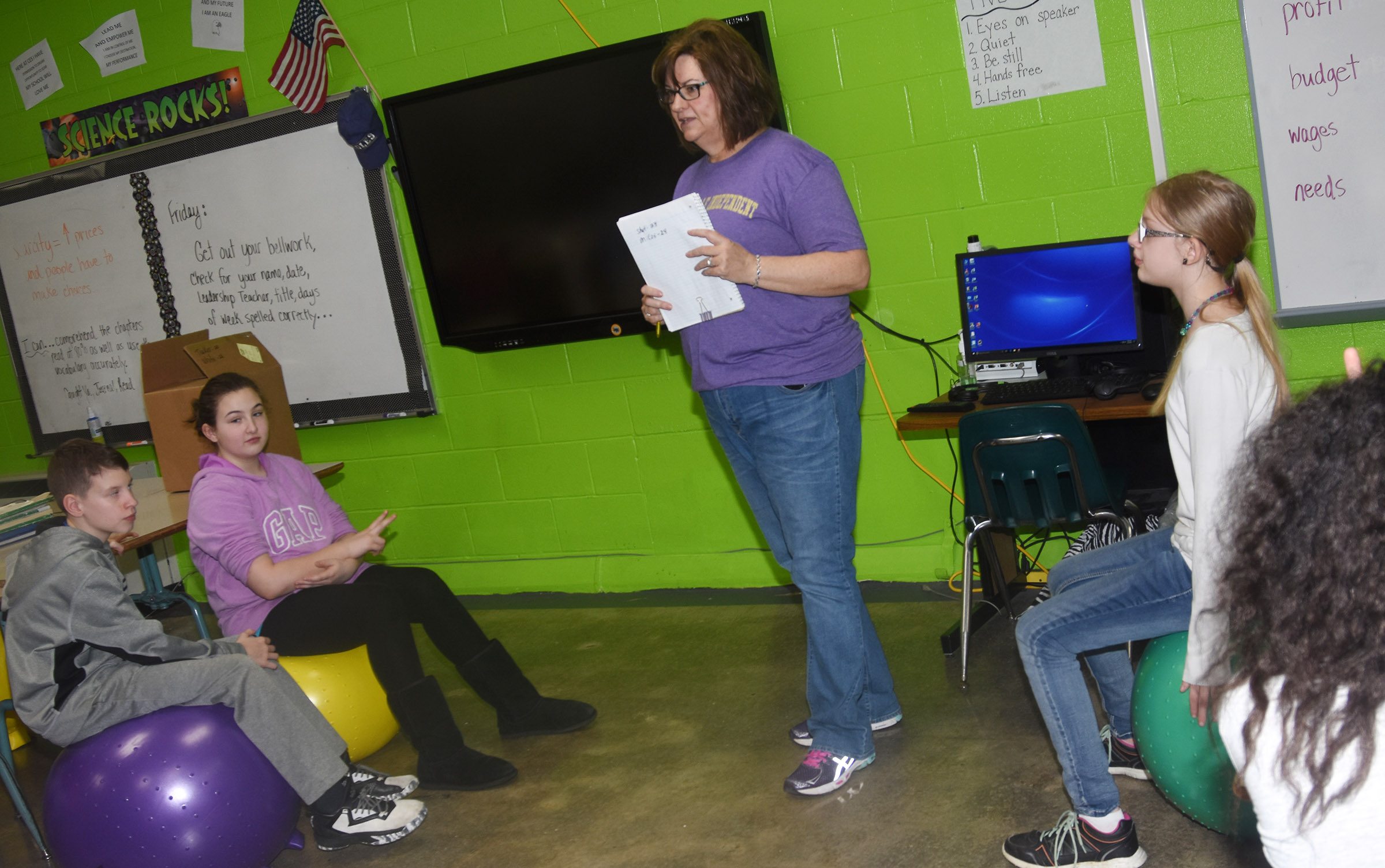 Susan Kennon, a Campbellsville Family Resource and Youth Services Center liaison at CES, talks to fifth-graders about why they should always brush their teeth twice a day.