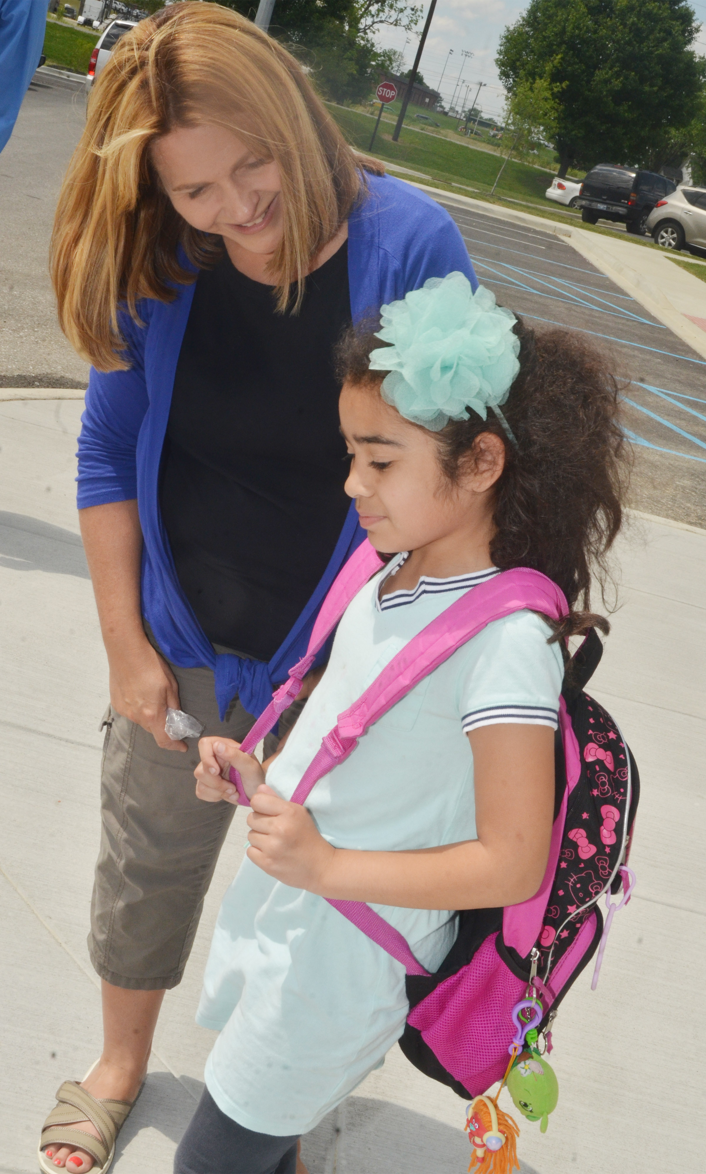 CES Guidance Counselor Sonya Orberson talks to second-grader Sophia Santos as she waits for her ride home.