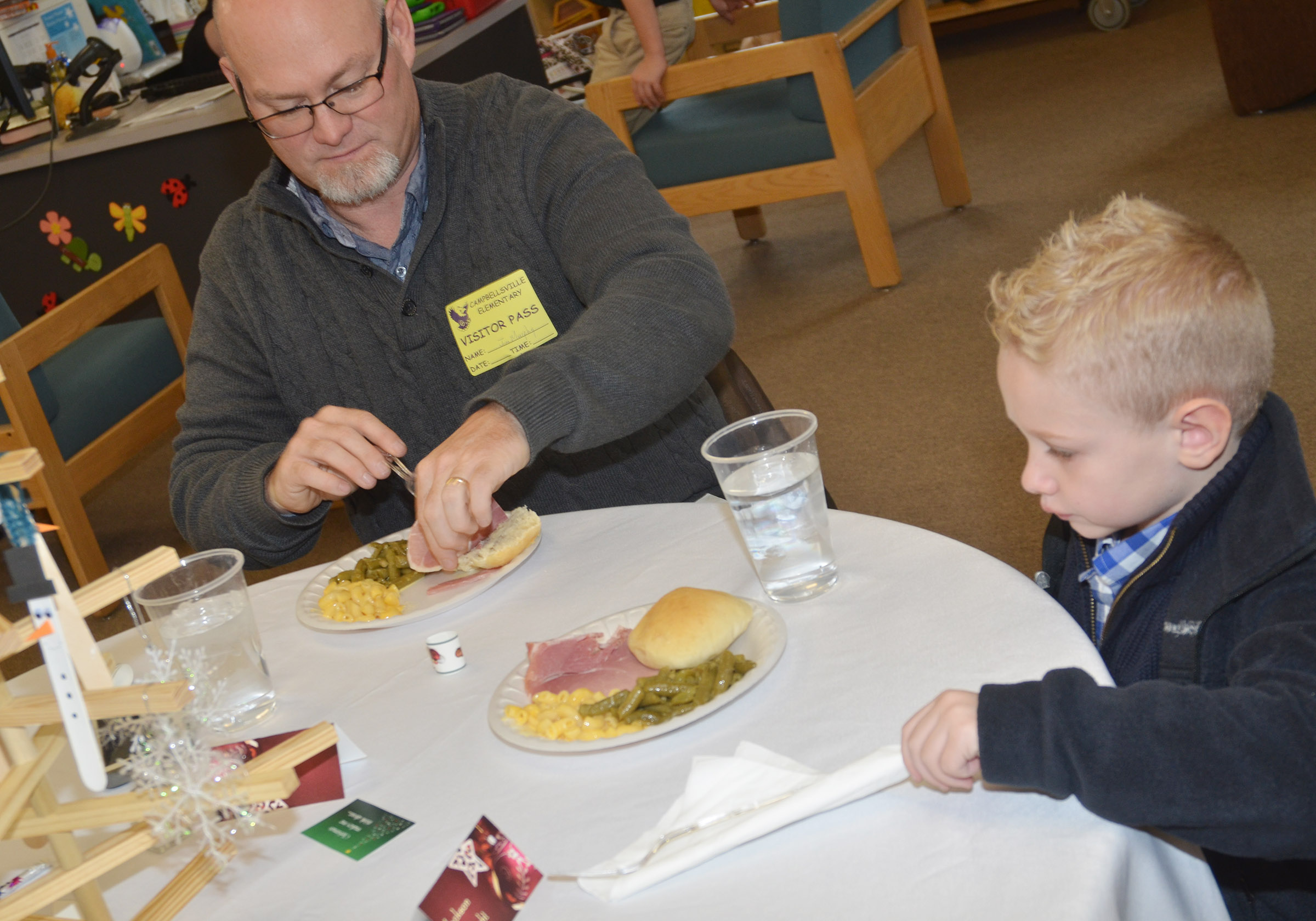 The Rev. Jim Murphy, pastor at Bethel First Presbyterian Church, has lunch with CES kindergartener Jackson Wright.