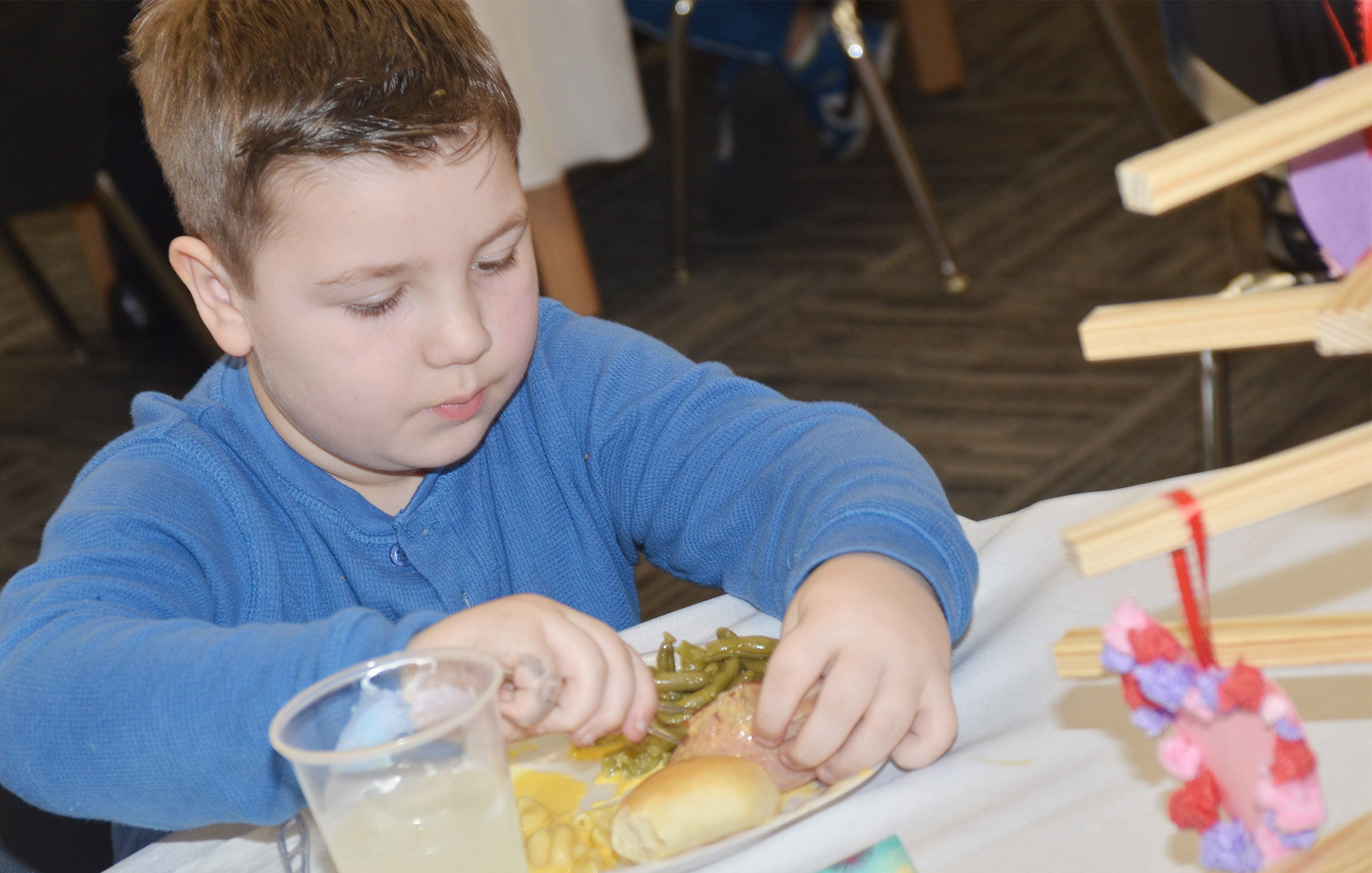 CES first-grader Luke Mardis enjoys his lunch.