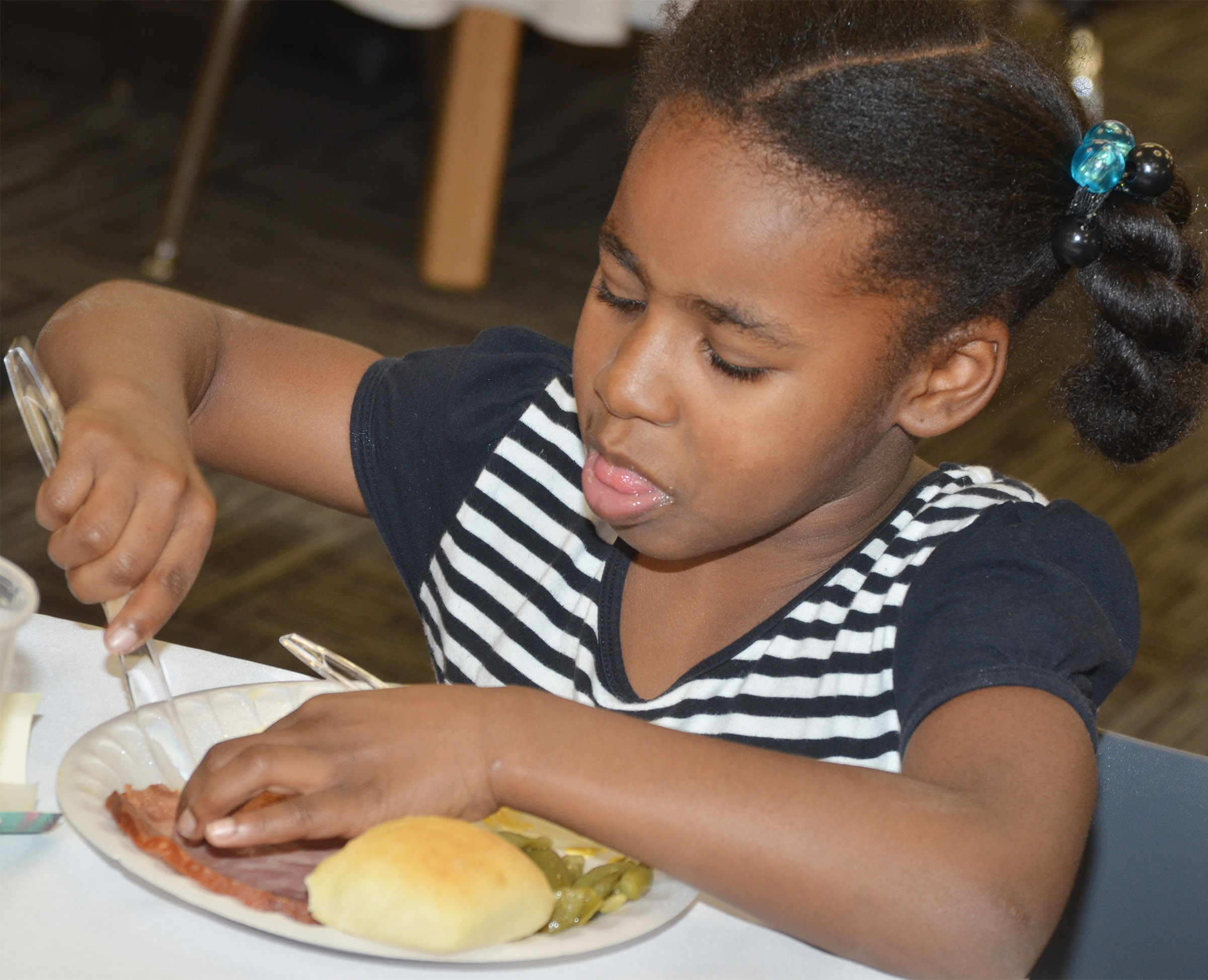 CES first-grader Destini Gholston eats her lunch.