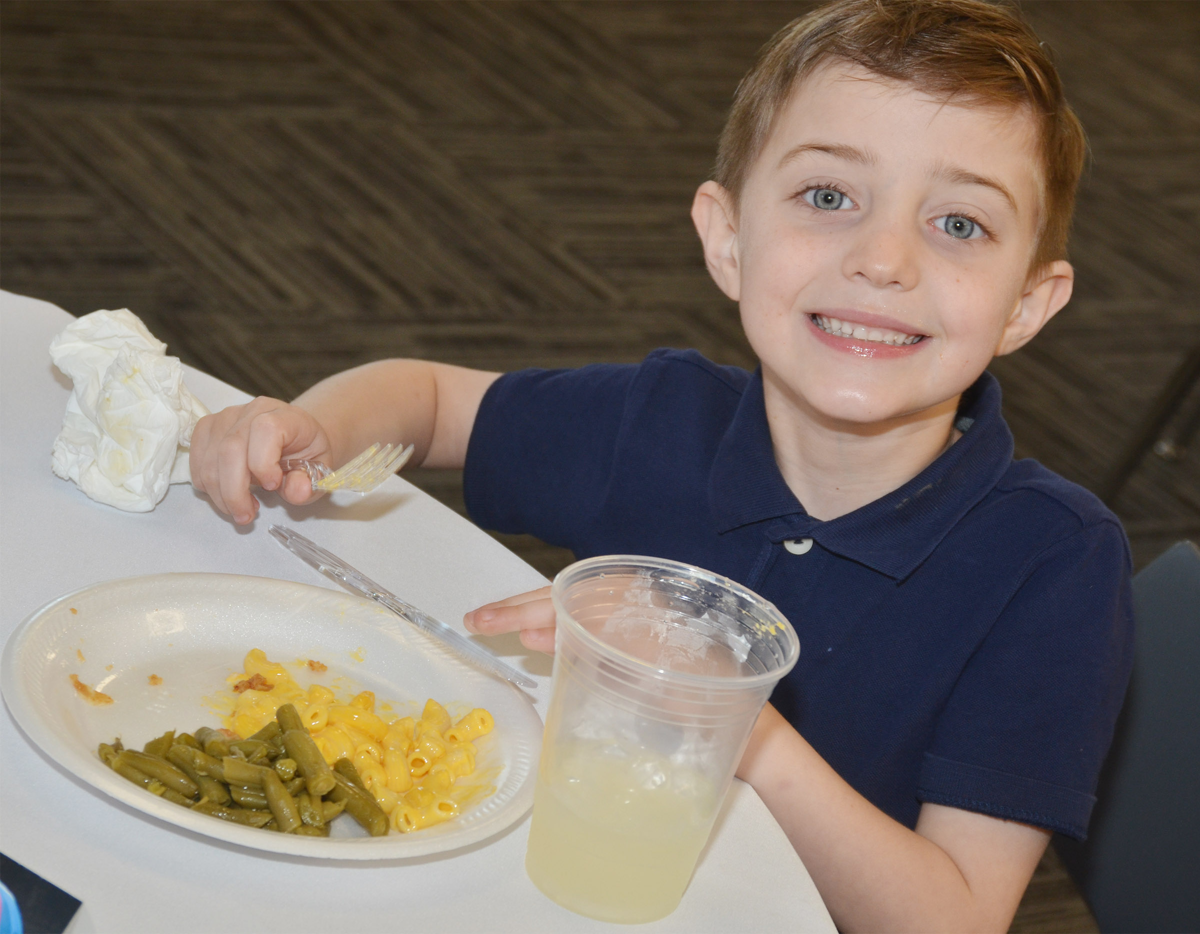 CES kindergartener Caleb Goodson enjoys his macaroni and cheese and green beans.