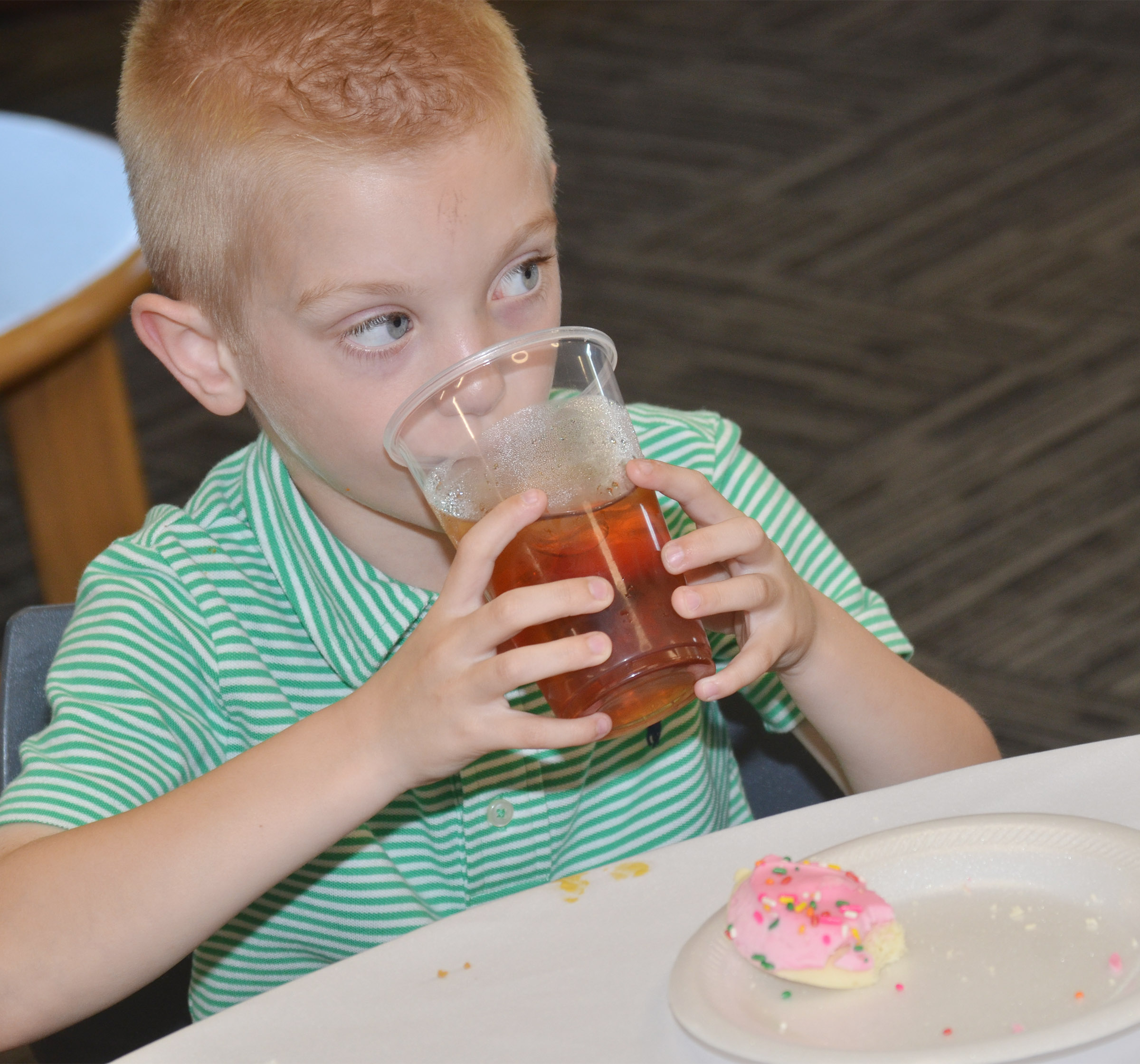 CES second-grader Evan Cundiff takes a drink of his tea.