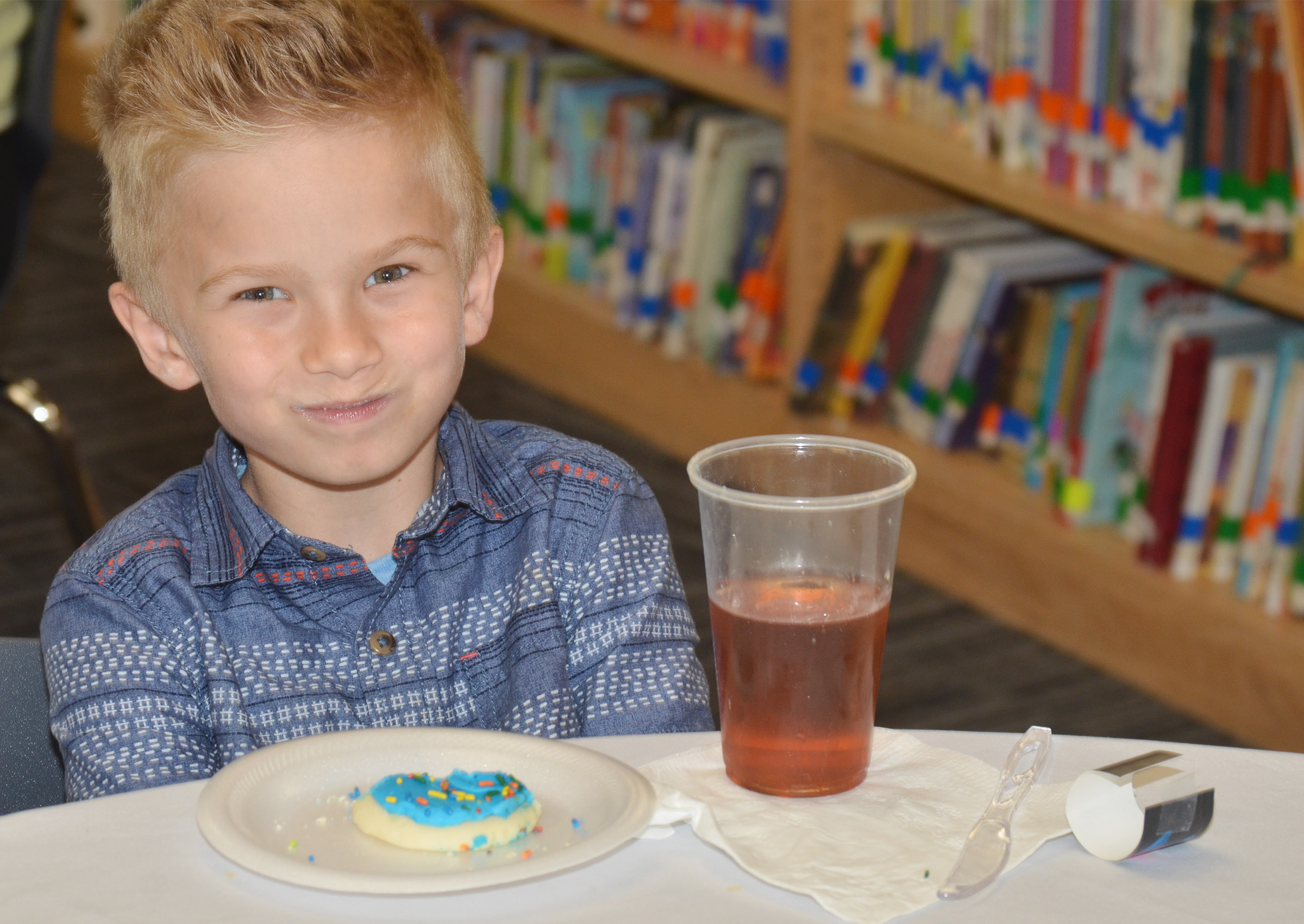CES first-grader Parker Hamilton smiles as he enjoys his cookie for dessert.