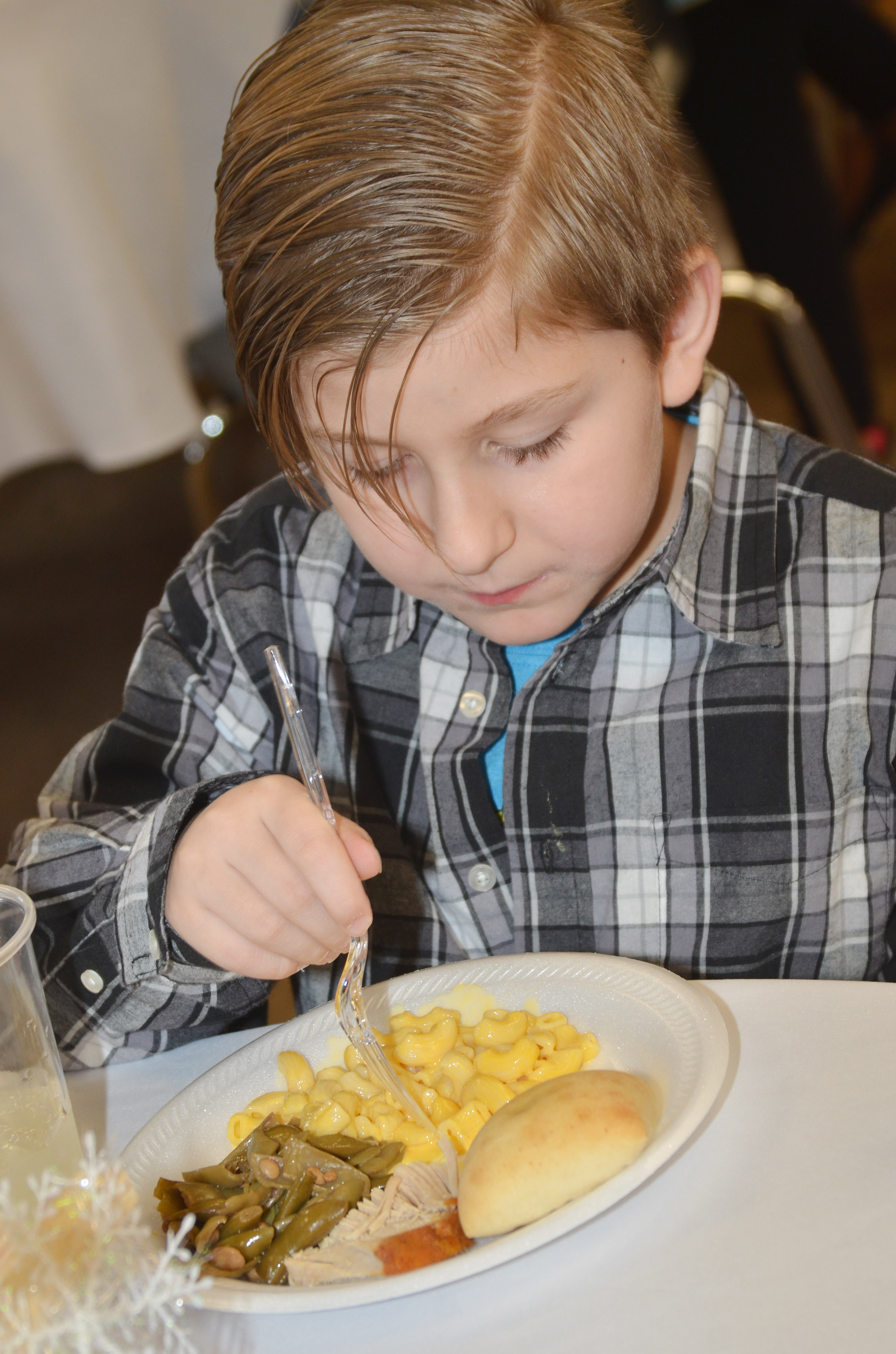 CES first-grader Tommy Caswell enjoys his macaroni and cheese.