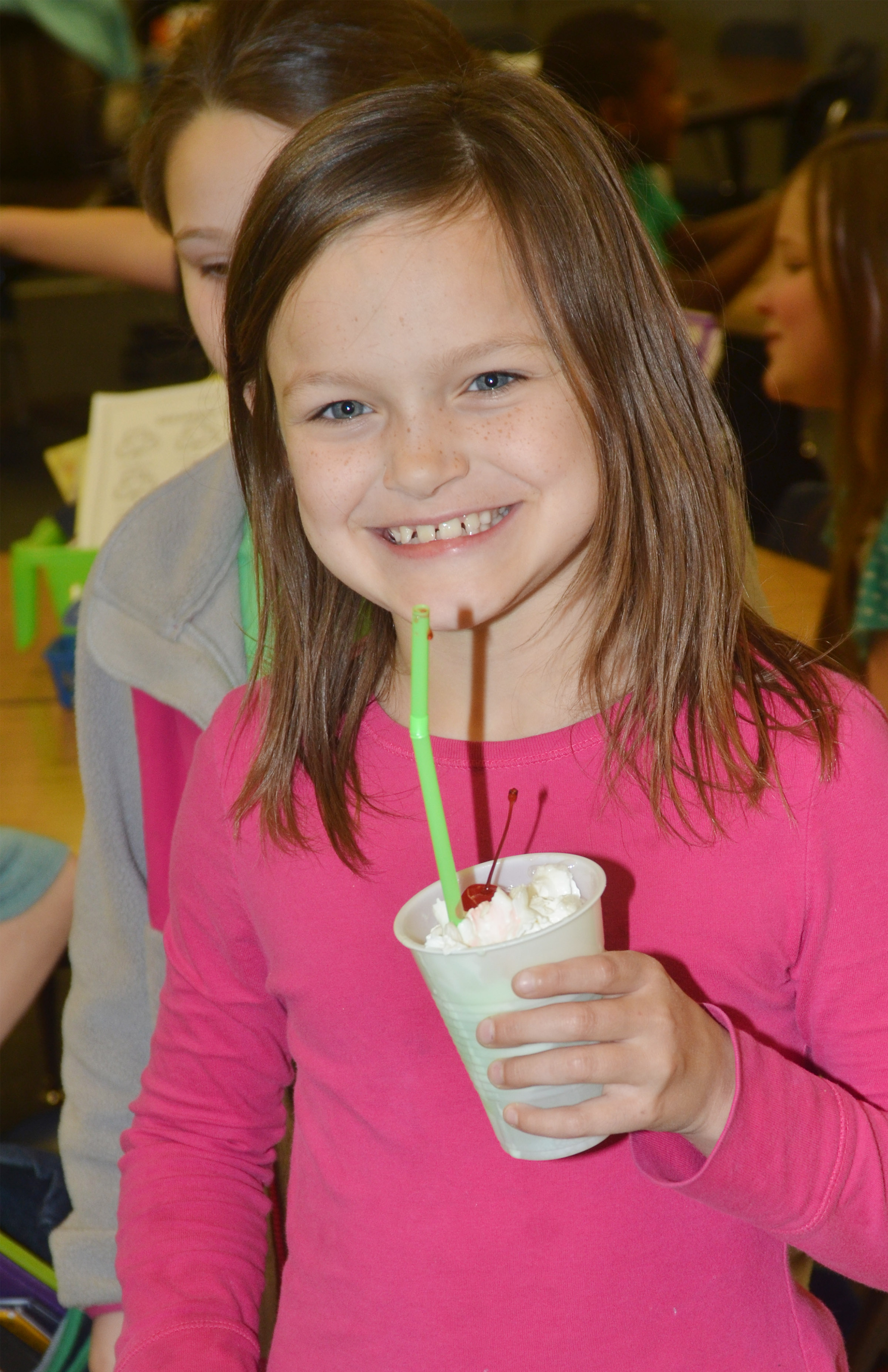 CES second-grader KayLee Lamer enjoys her leprechaun float.