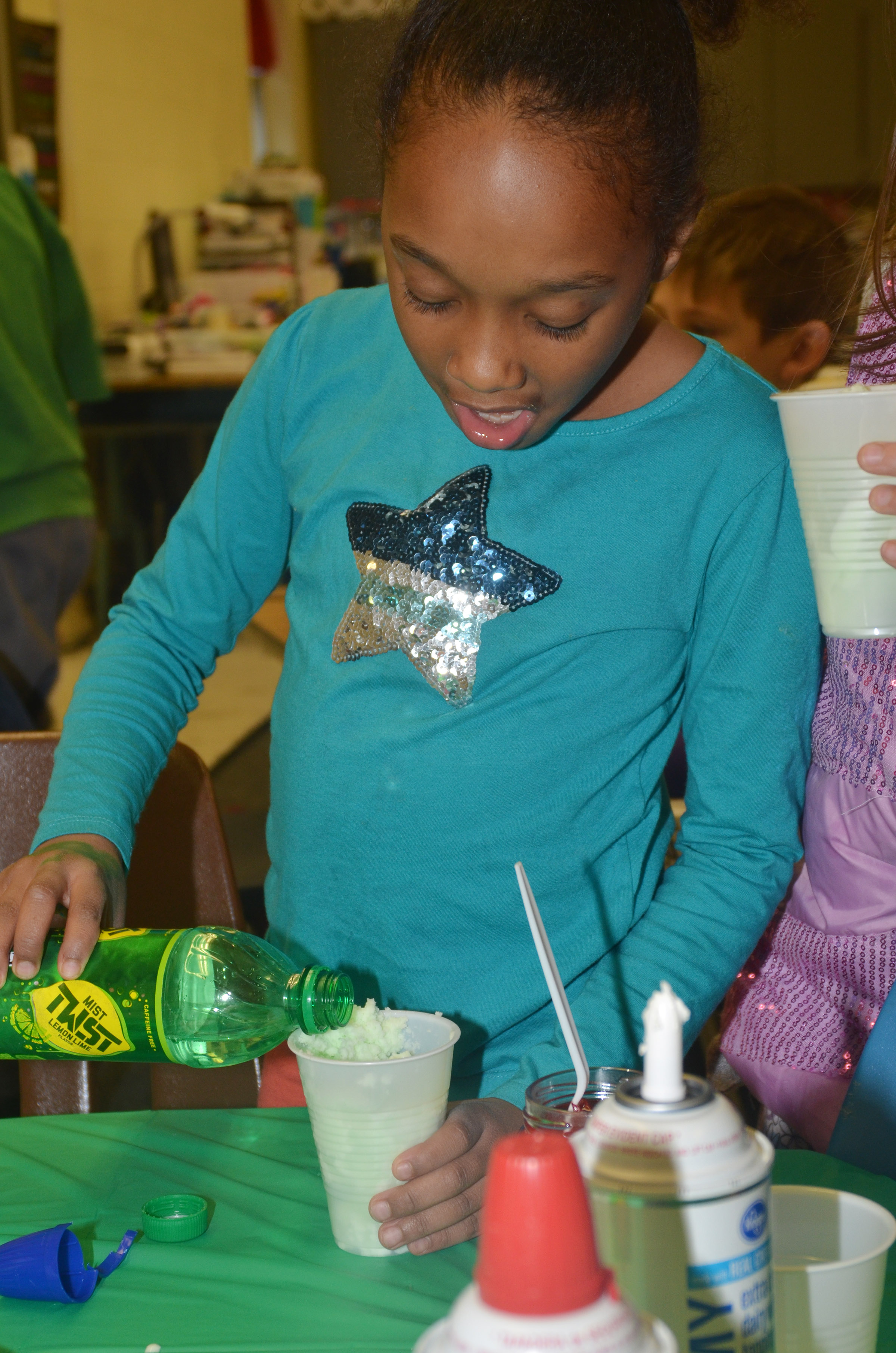 CES second-grader Lashonda Wilkinson adds soda to her leprechaun float.
