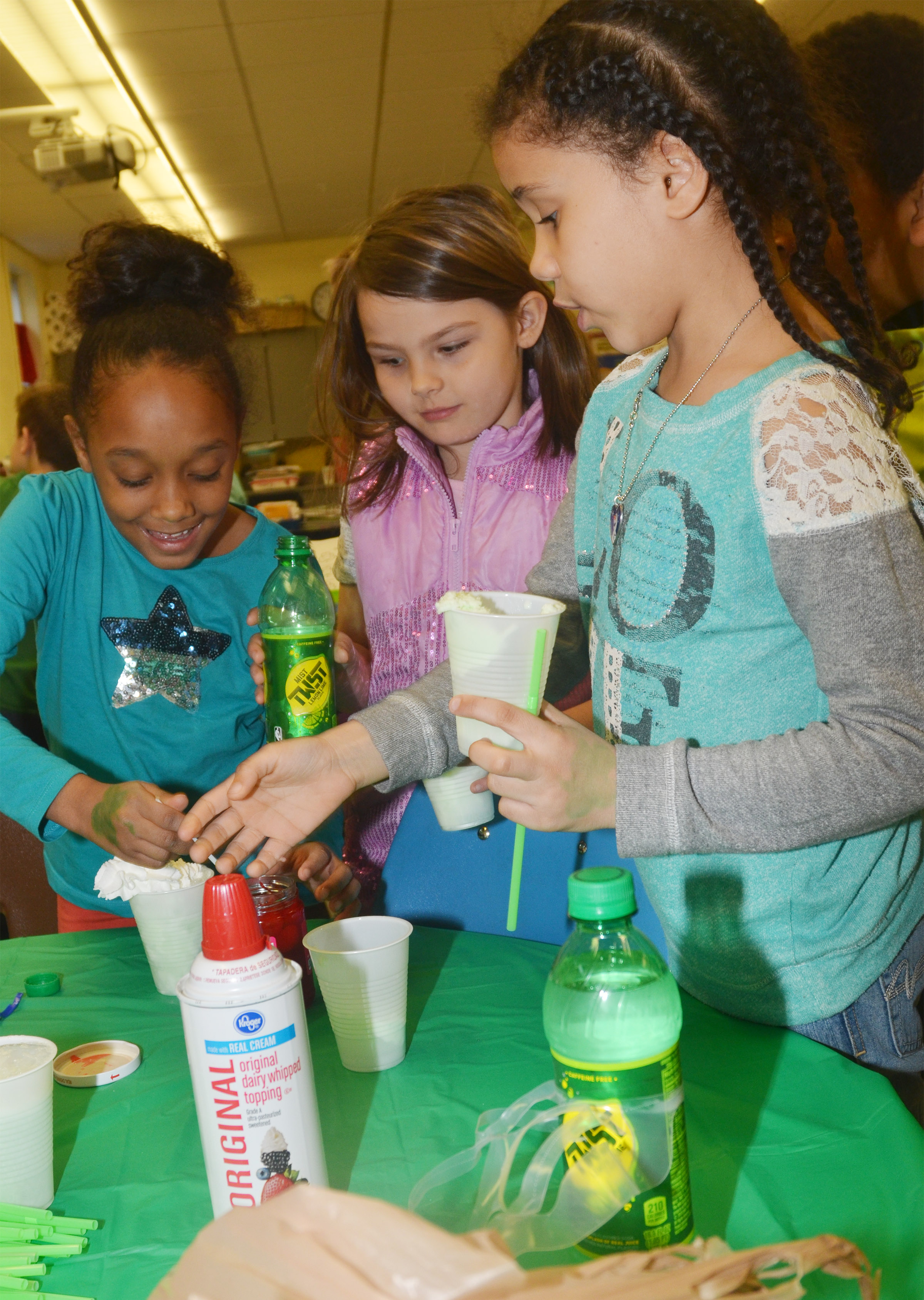 CES second-graders, from left, Lashonda Wilkinson, Dorothy Shively and Alex Wilson make their leprechaun floats.