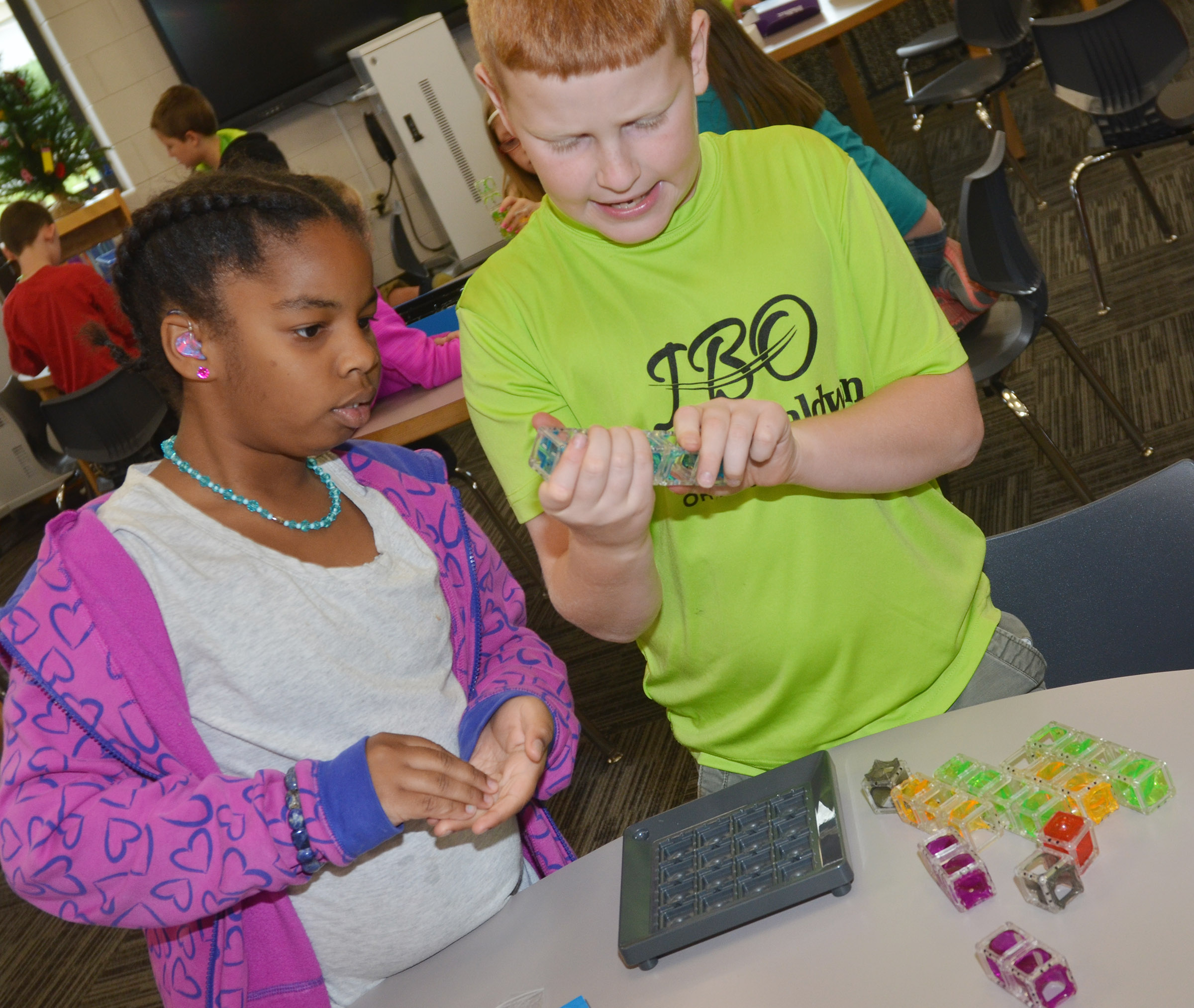 CES fourth-grader KaMiya Williams, at left, and Westin Dudgeon build together.