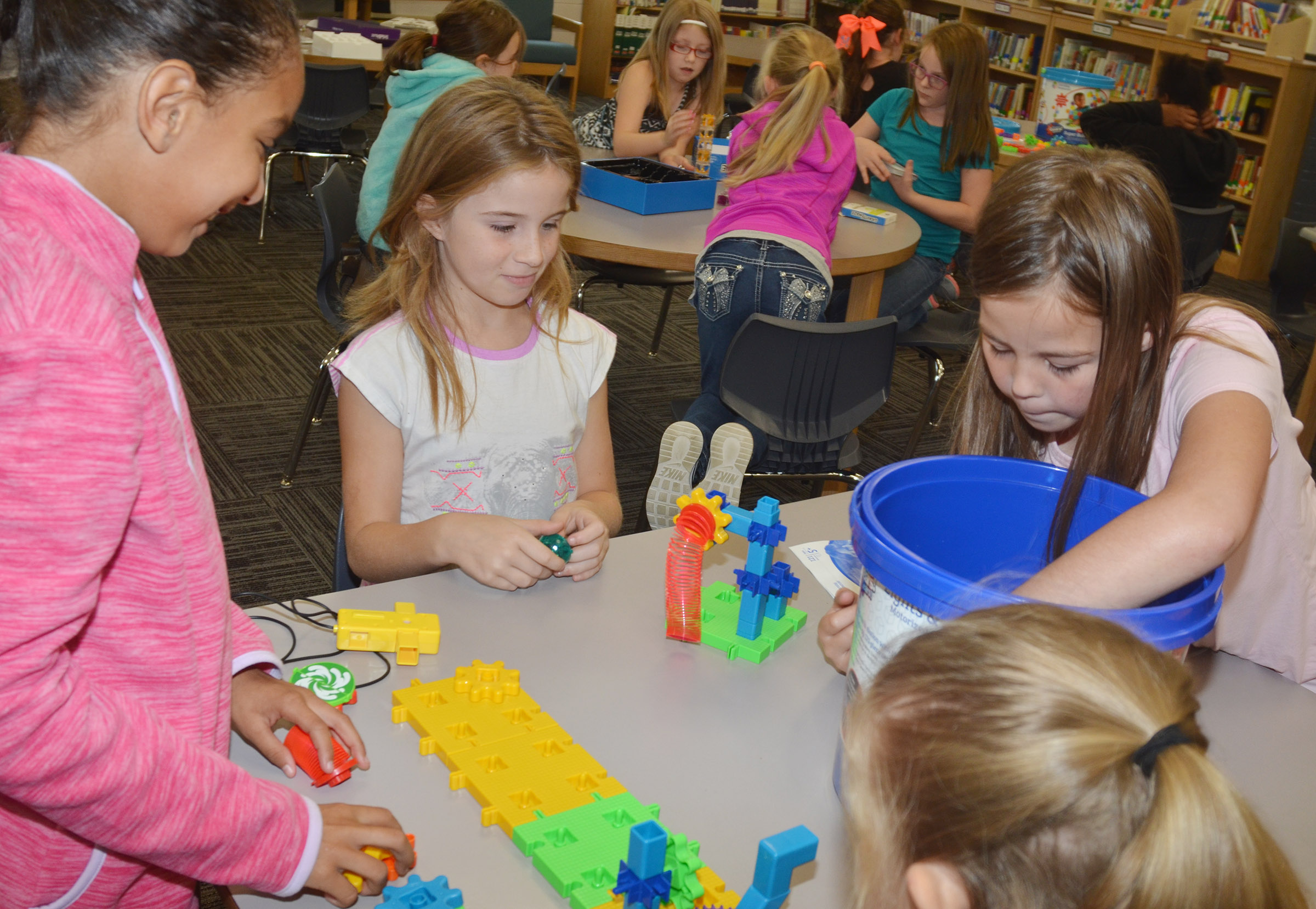 From left, CES fourth-graders Alyssa Knezevic, Raegan Hayes and Chloe Bates build with STEM toys.