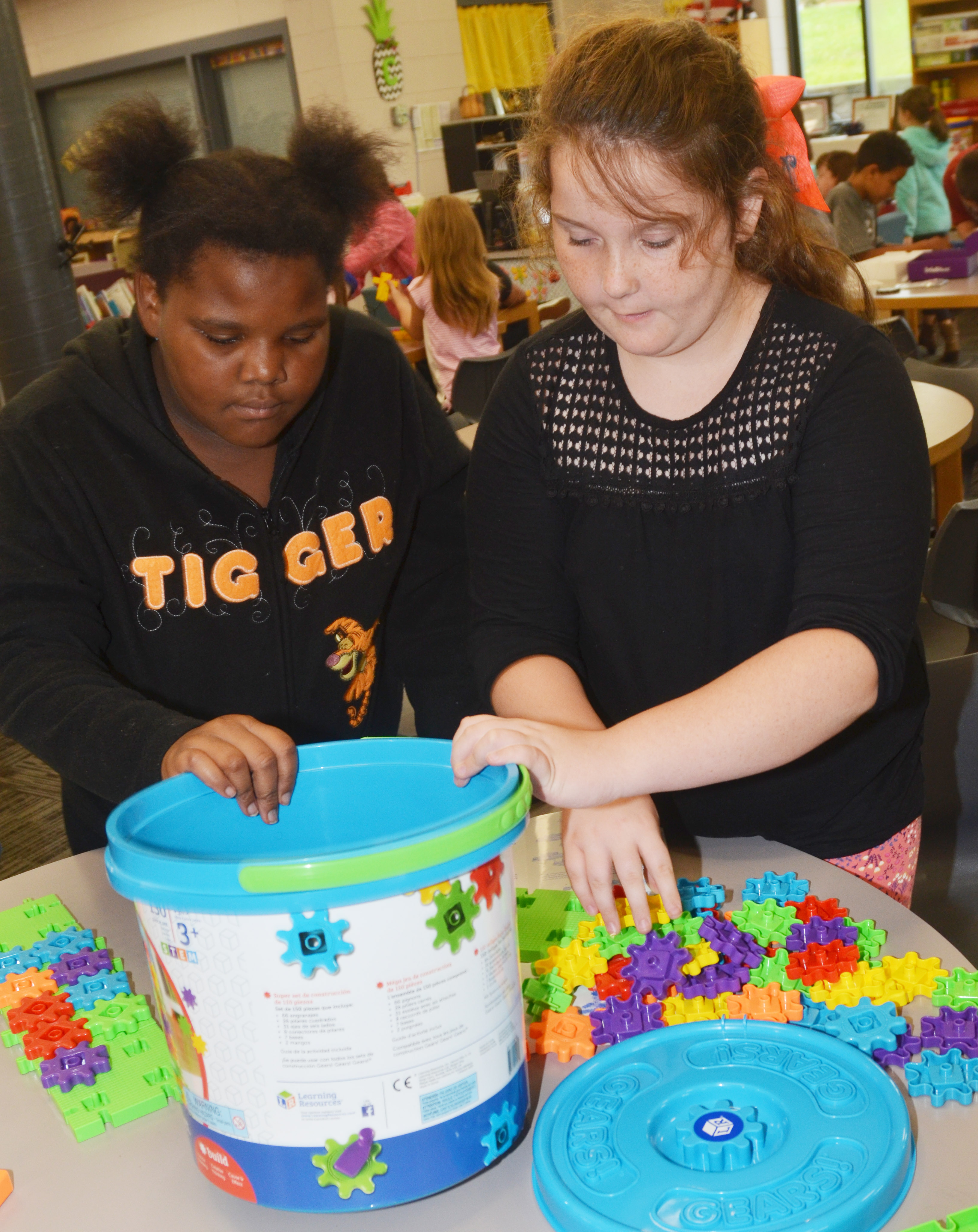 CES fourth-graders Talaysia Daniels, at left, and Madison Philpott build with STEM toys.