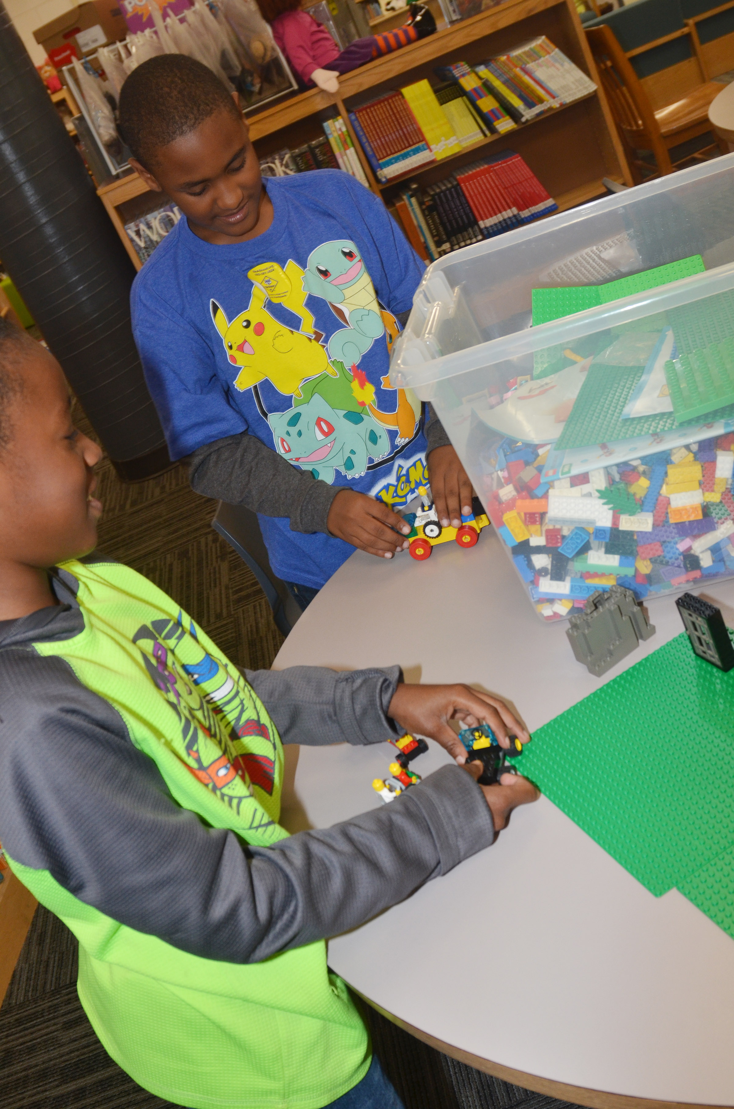 CES fourth-graders John Gholston, at left, and Shaiden Calhoun build together with Legos.