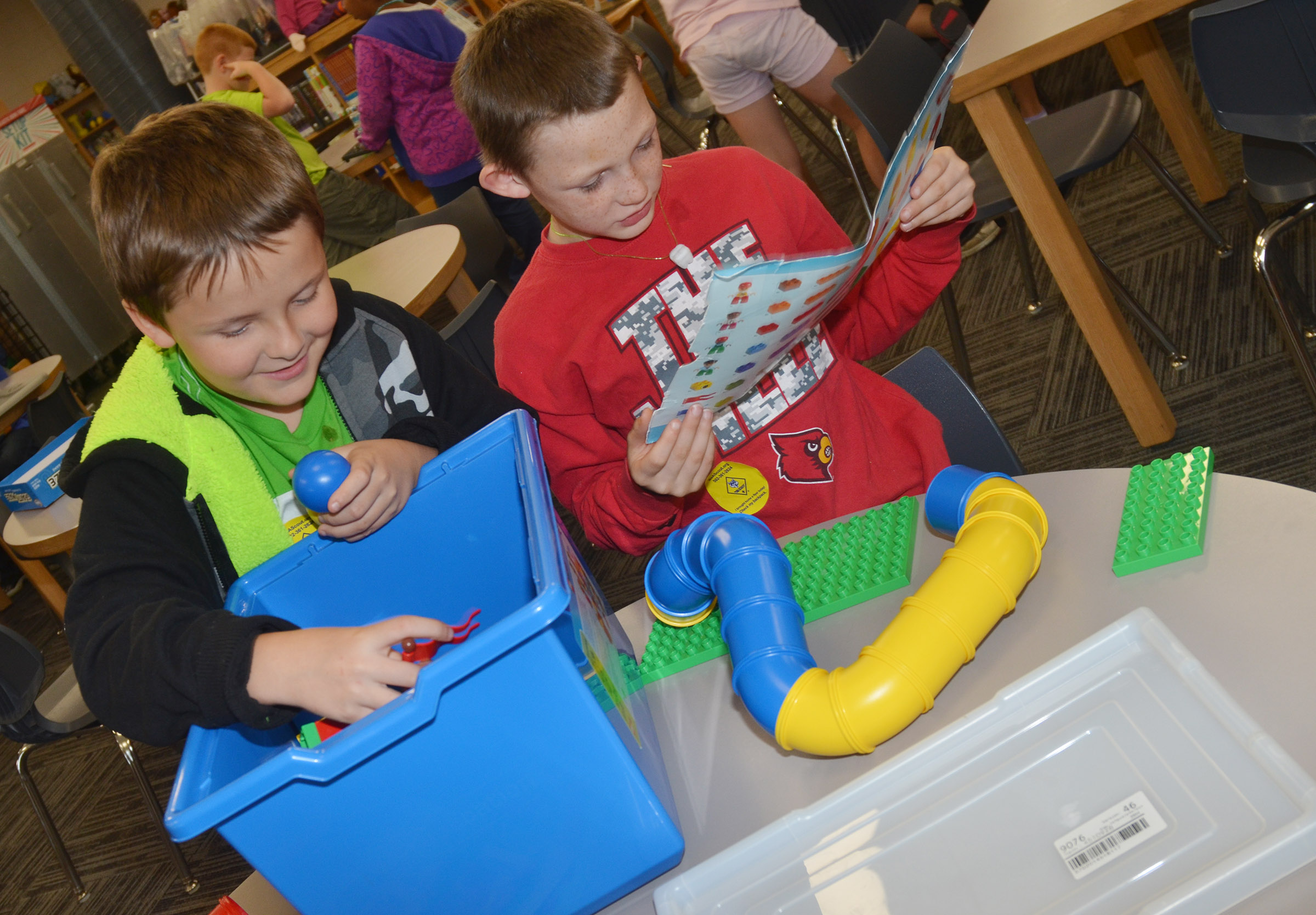 CES fourth-graders Daniel Shively, at left, and Cohutta Giles build together.