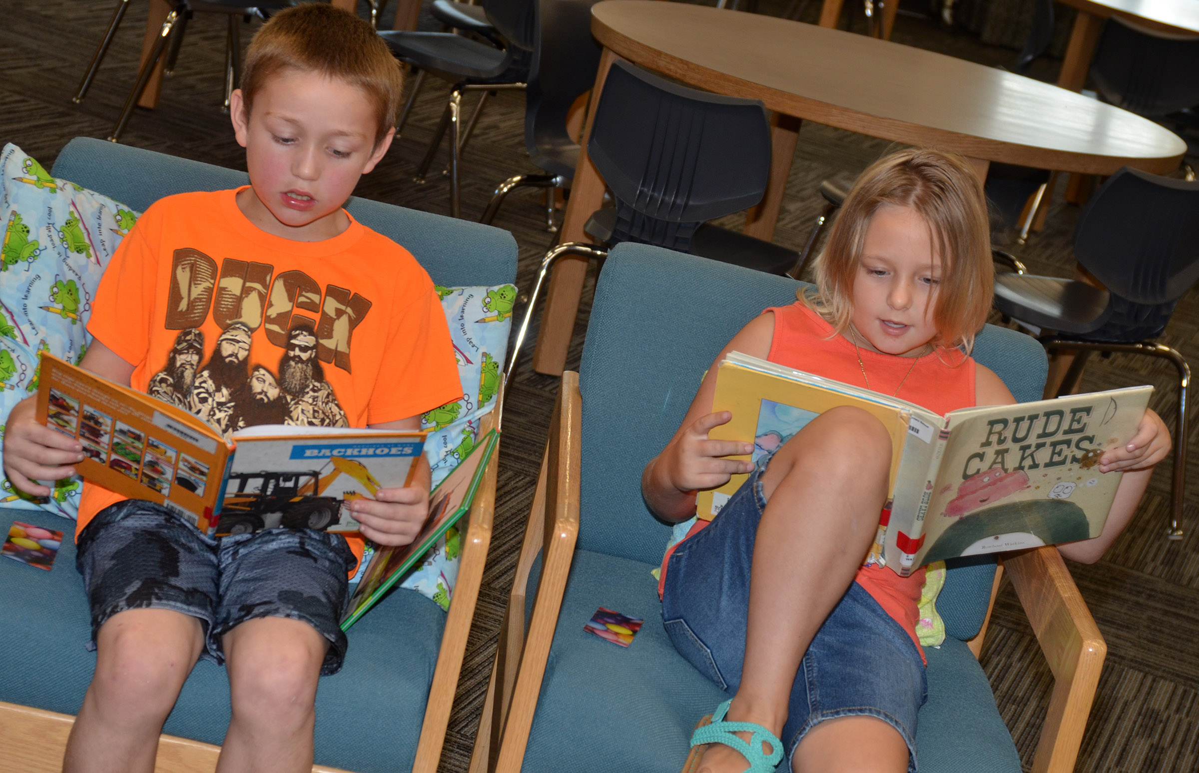 CES second-graders Jacob Golden, at left, and Allison Dean read together.