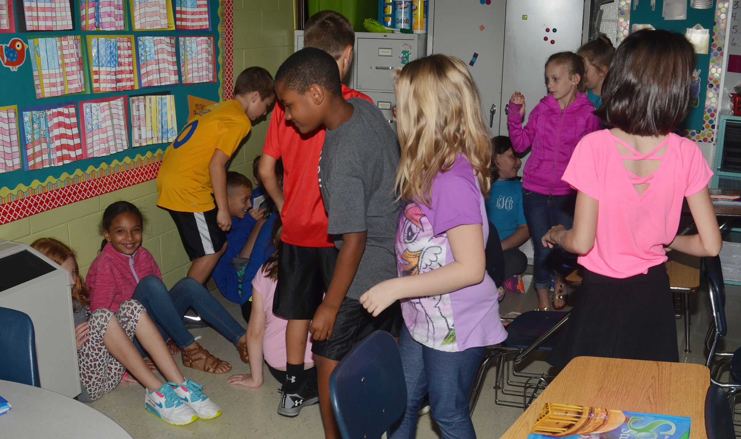CES fourth-graders in Kaye Agathen's class huddle together during a lockdown drill.