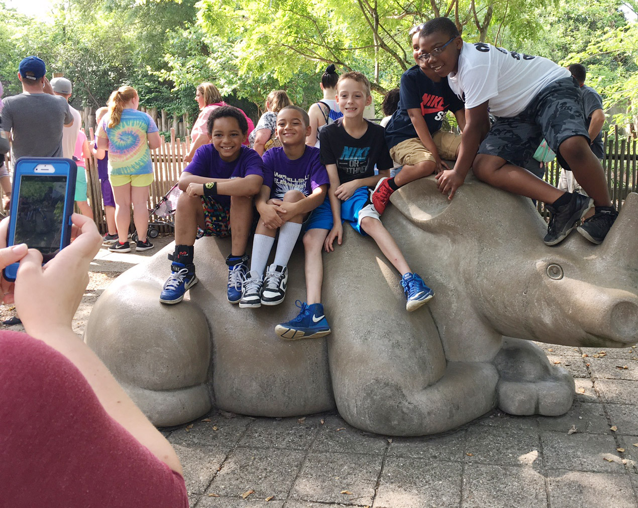 From left, CES third-graders Jalen Embry, Jaden Barbee, Caysen Tungate and Austin Sloan pose for a photo on an elephant statue.