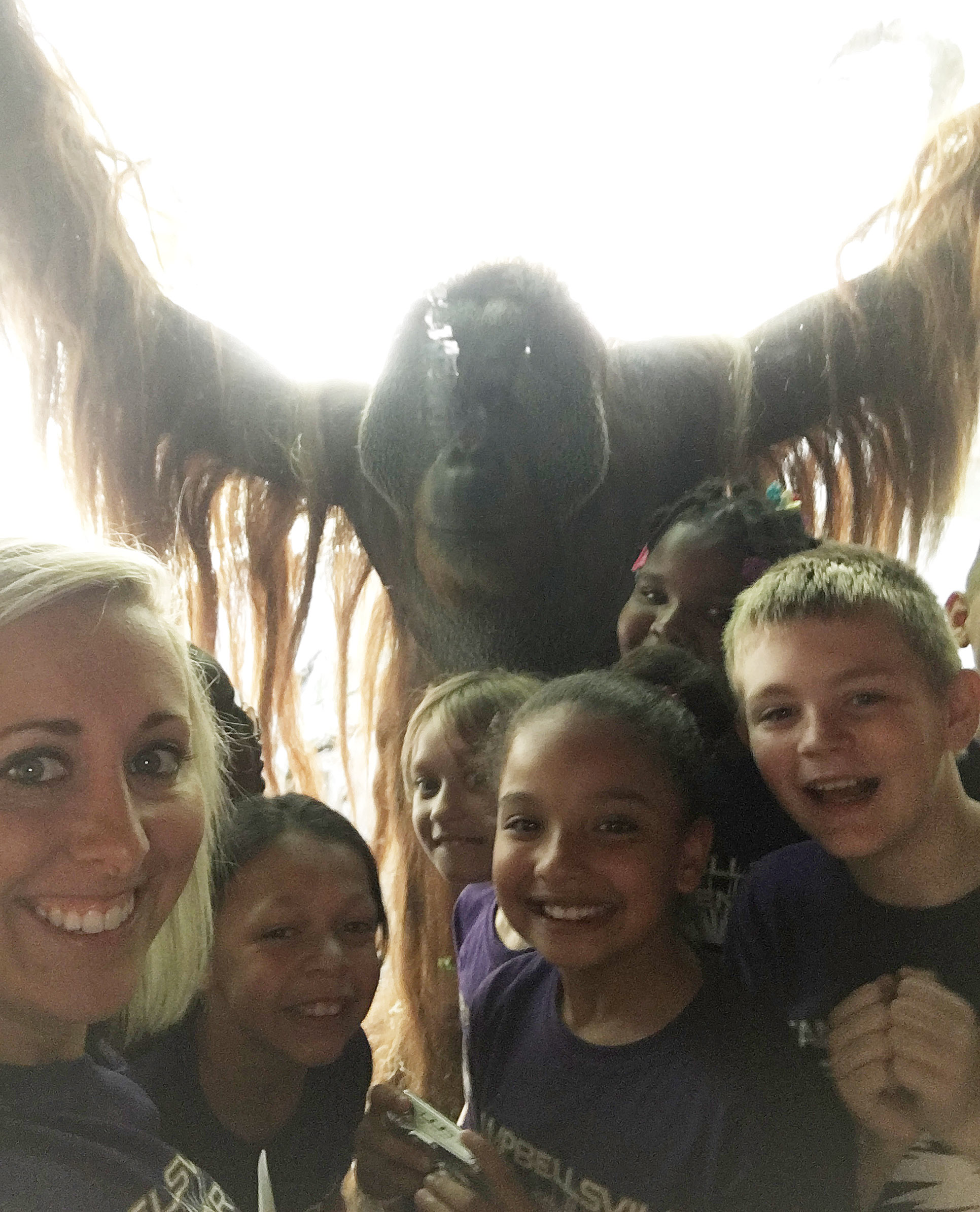 CES third-grade teacher Hannah Jones takes a photo with her students – and a gorilla.