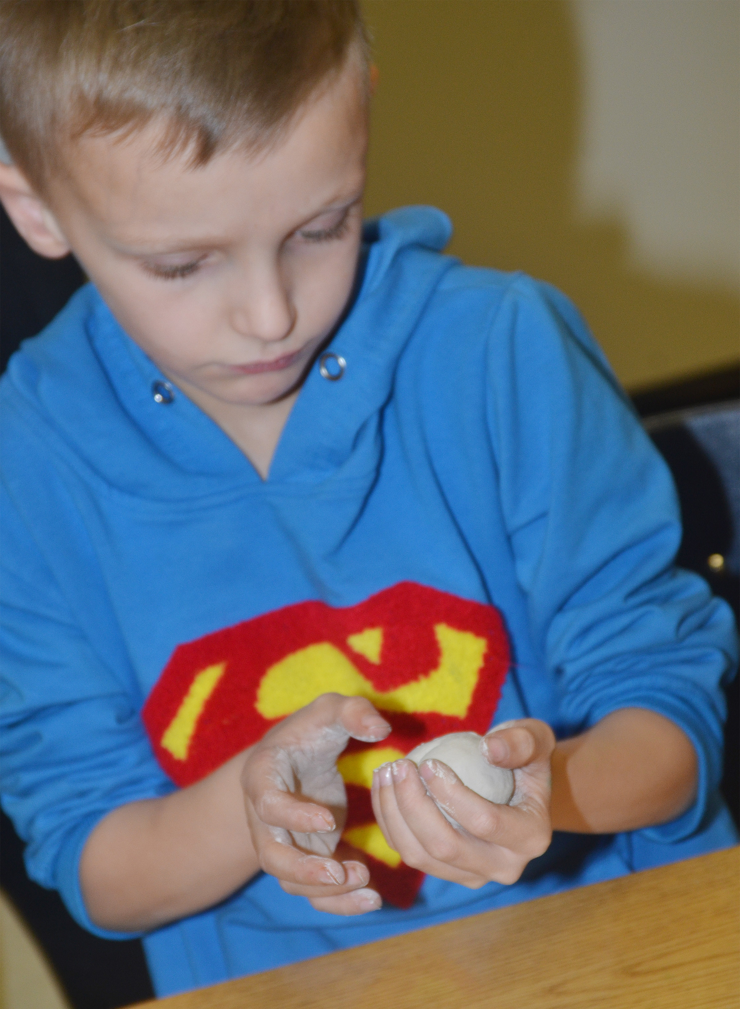 CES second-grader Aaron Ritchie uses his hands to mold his clay.