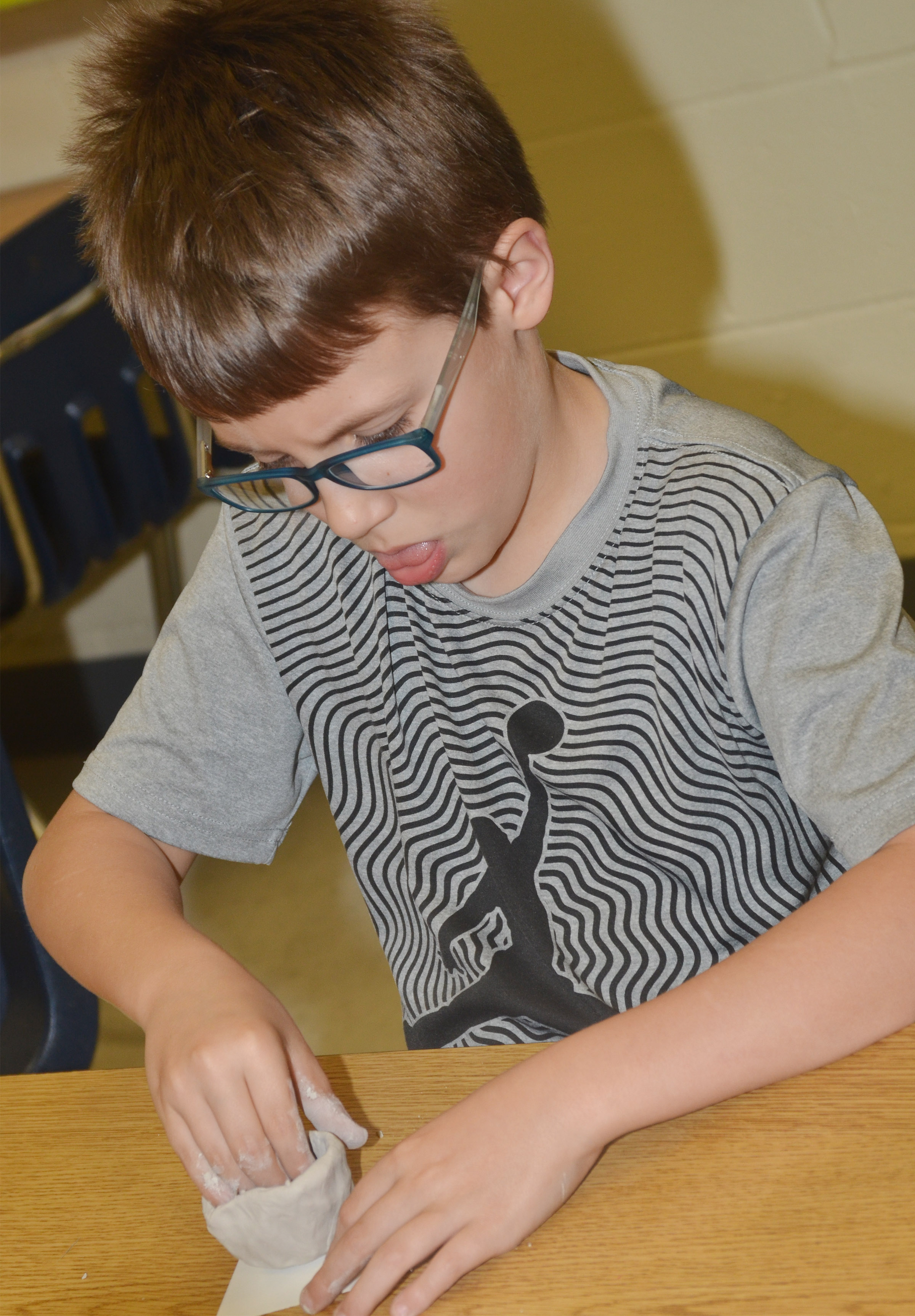 CES second-grader Dalton Shively shapes his pot.
