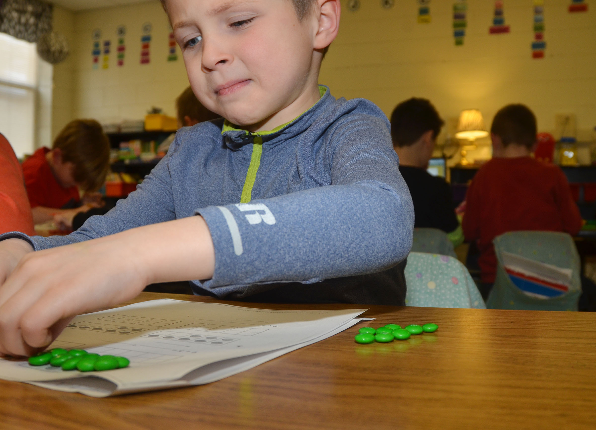 CES first-grader Bryson Gabehart counts with M&Ms.