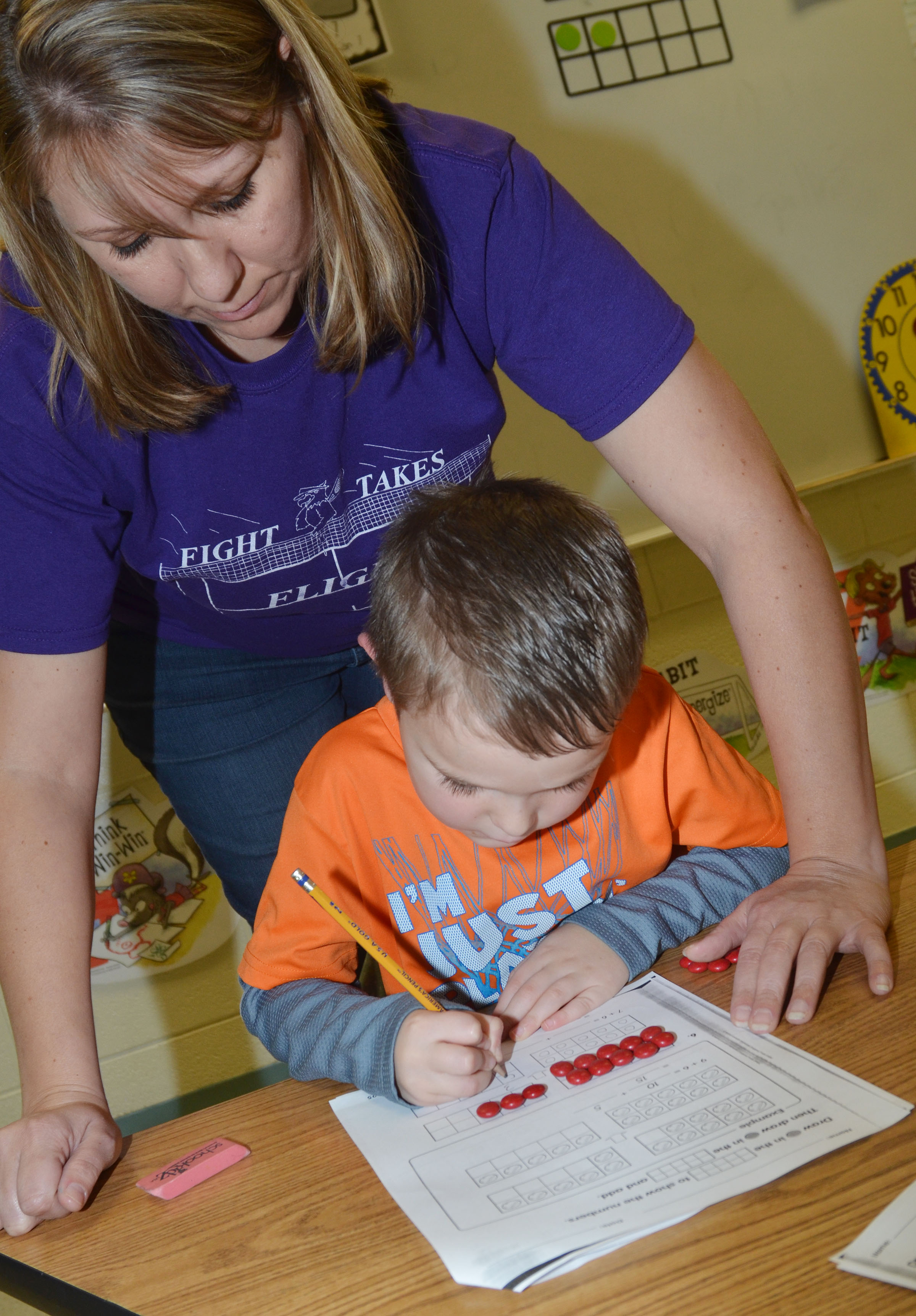 CES first-grade teacher Amanda Greer helps Karson Burchett with his math.