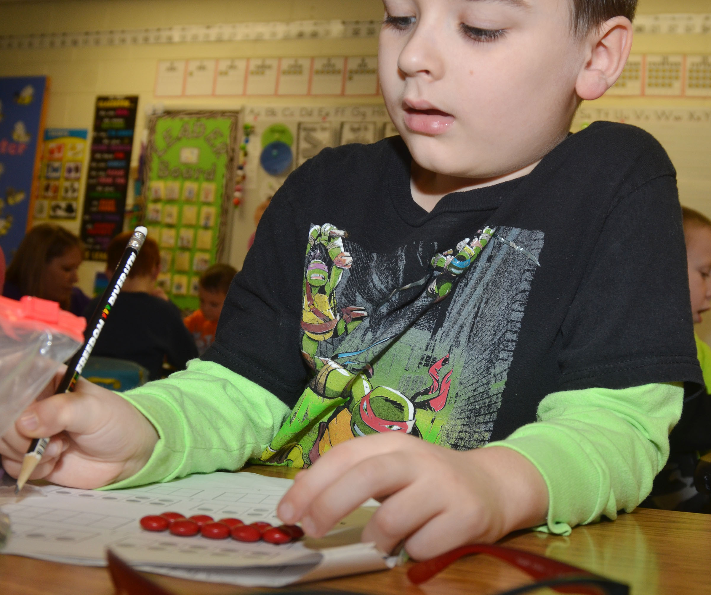 CES first-grader Sawyer Lange counts with his M&Ms.