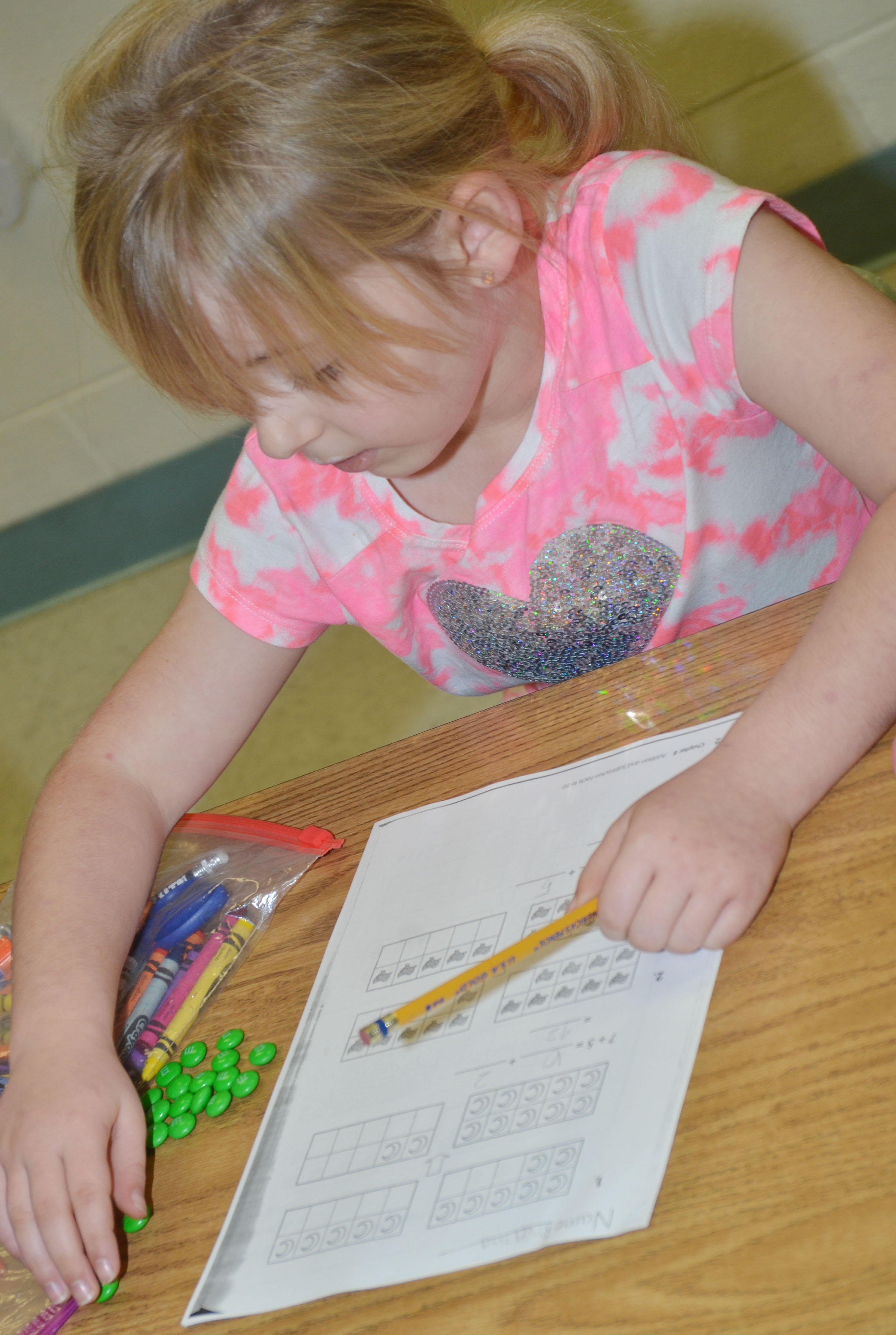 CES first-grader Breanna Callahan counts with her M&Ms.
