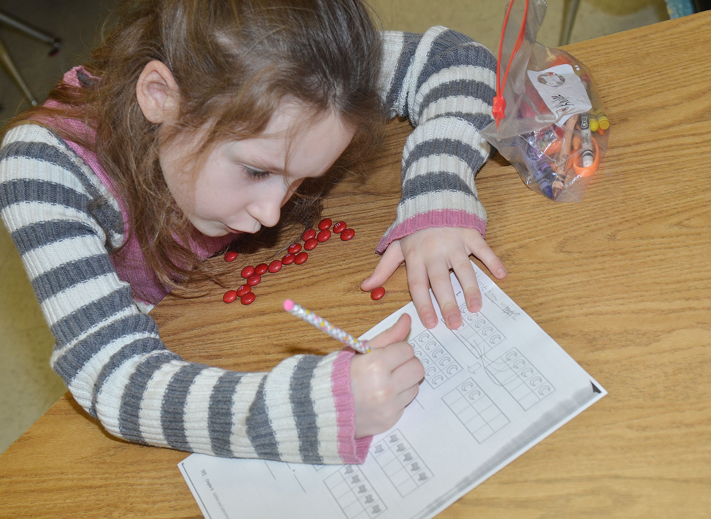 CES first-grader Kaylee Gayheart counts with her M&Ms.