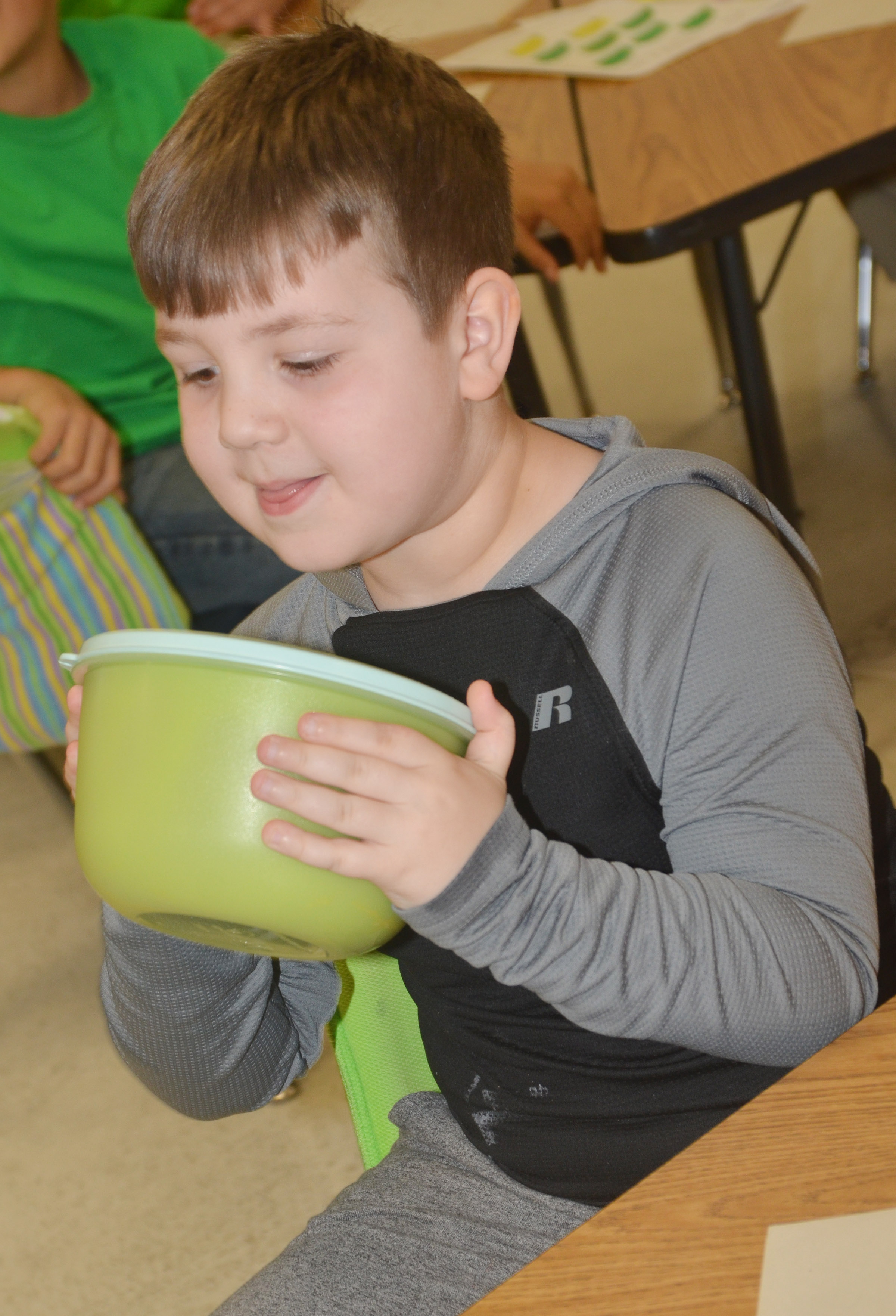 CES first-grader Luke Mardis shakes the pudding mixture.