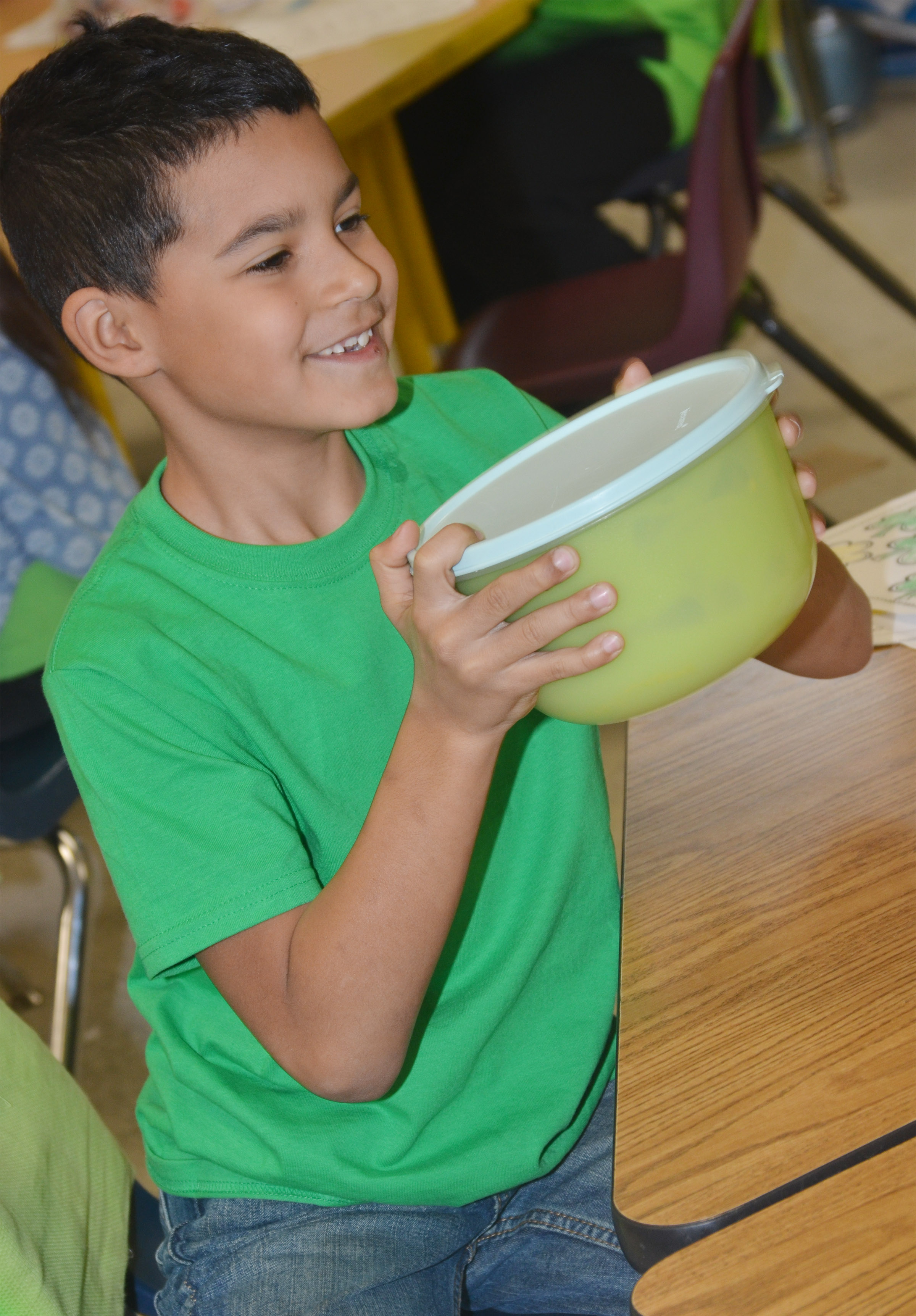 CES first-grader Rizzo McKenzie shakes the pudding mixture.