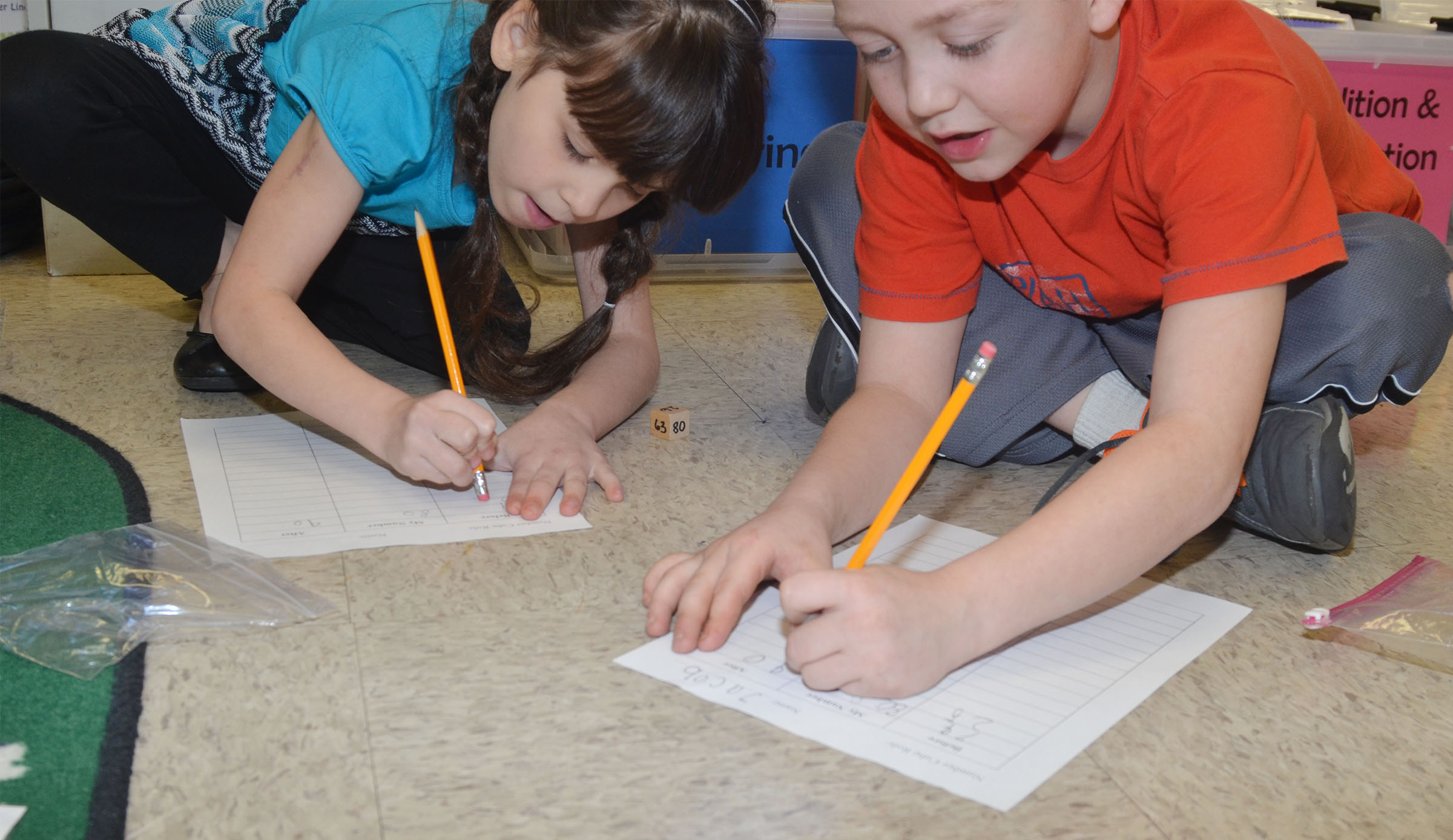 CES first-graders Phoebe Ritchie, at left, and Jacob Golden play a math game together.