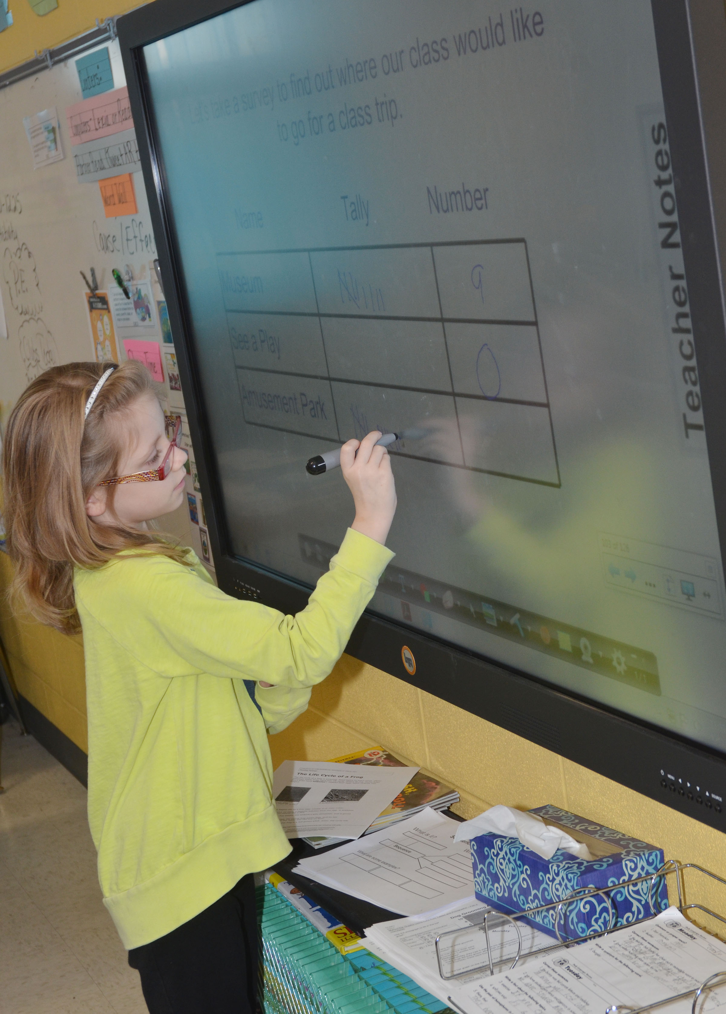 CES third-grader Gracie Pendleton records how many students would like to go to an amusement park.