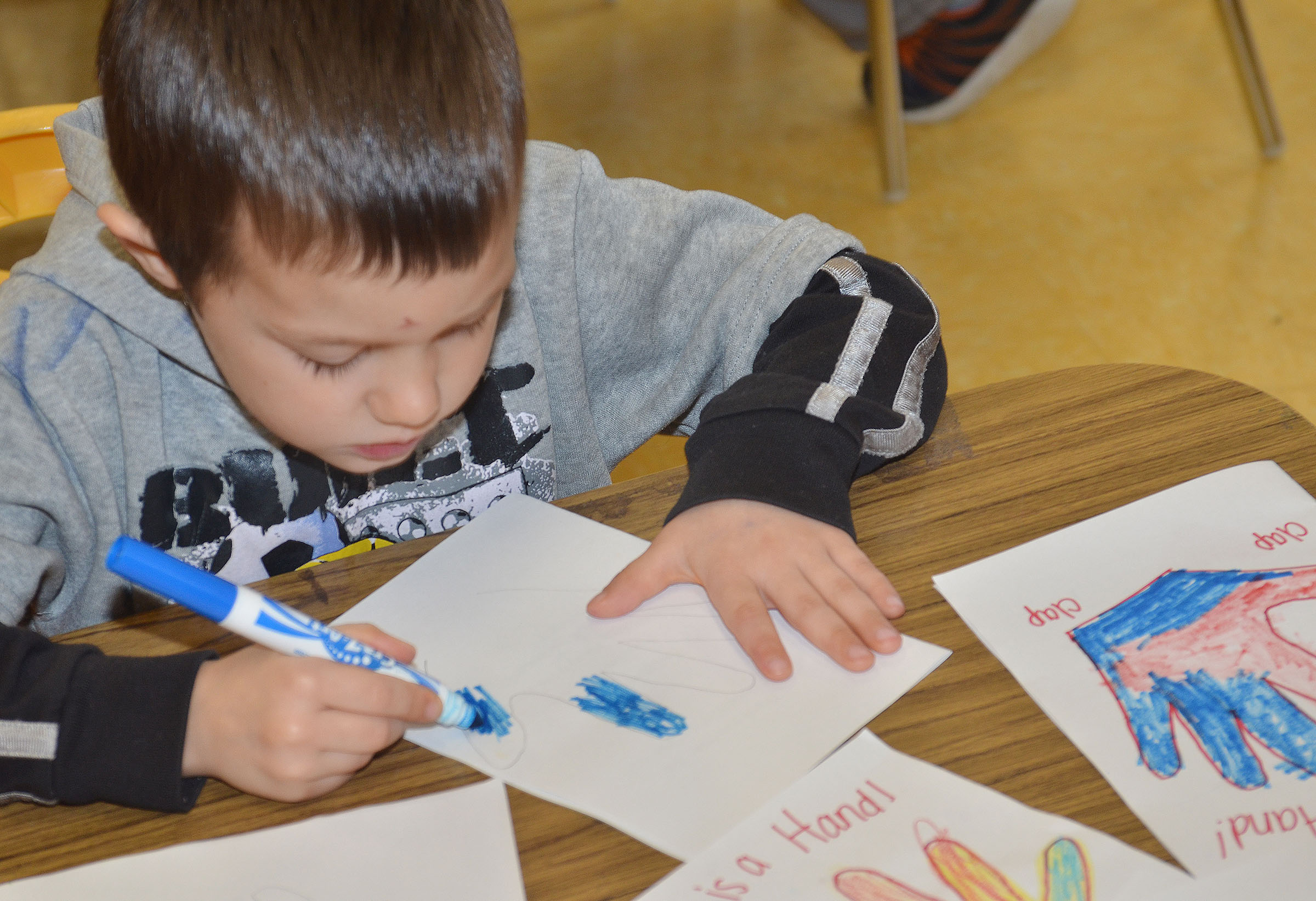 CES preschool student Levi Ritchie colors a card he made for an active duty soldier.