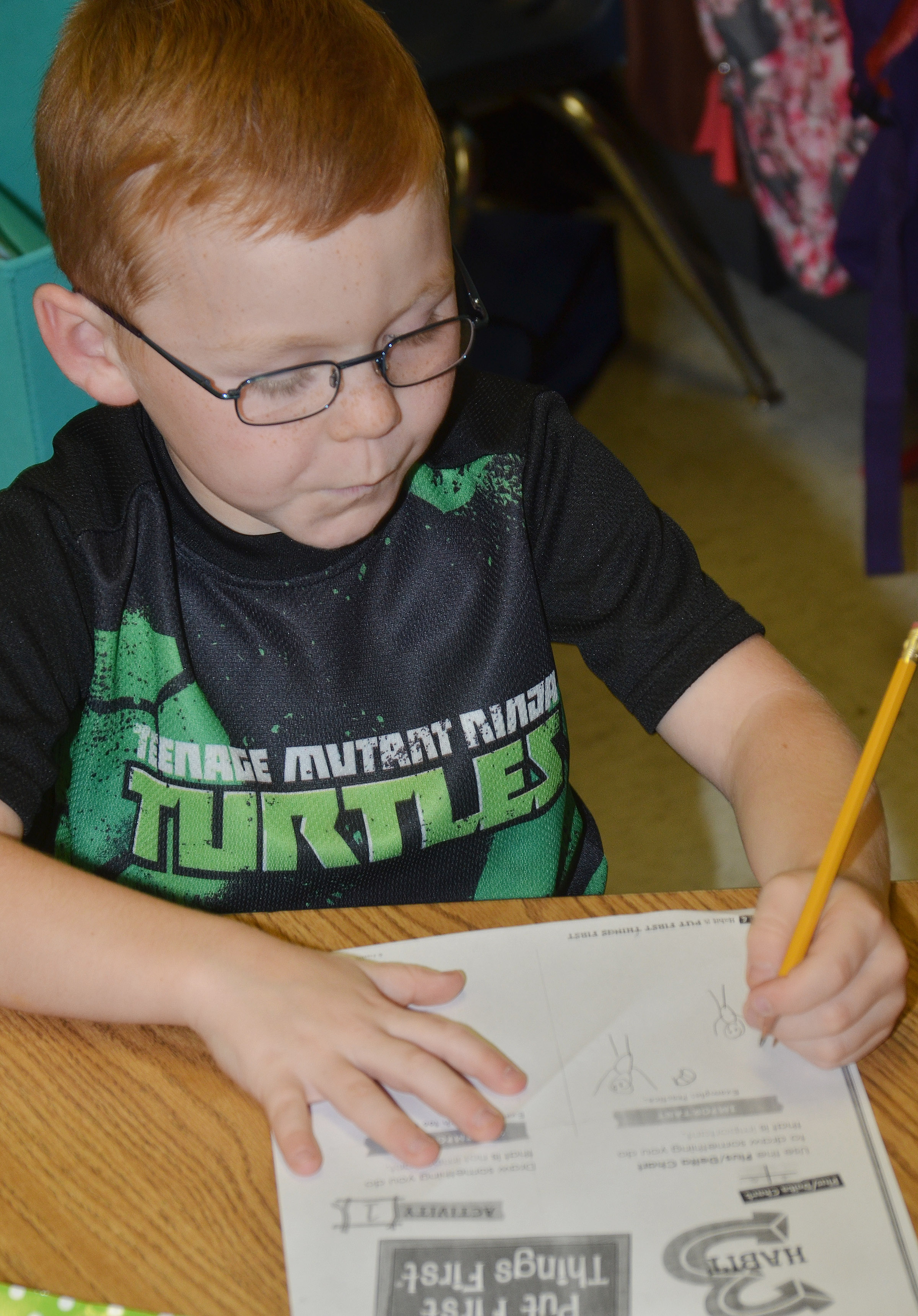 CES first-grader Daven Davis draws a picture of something that is important.