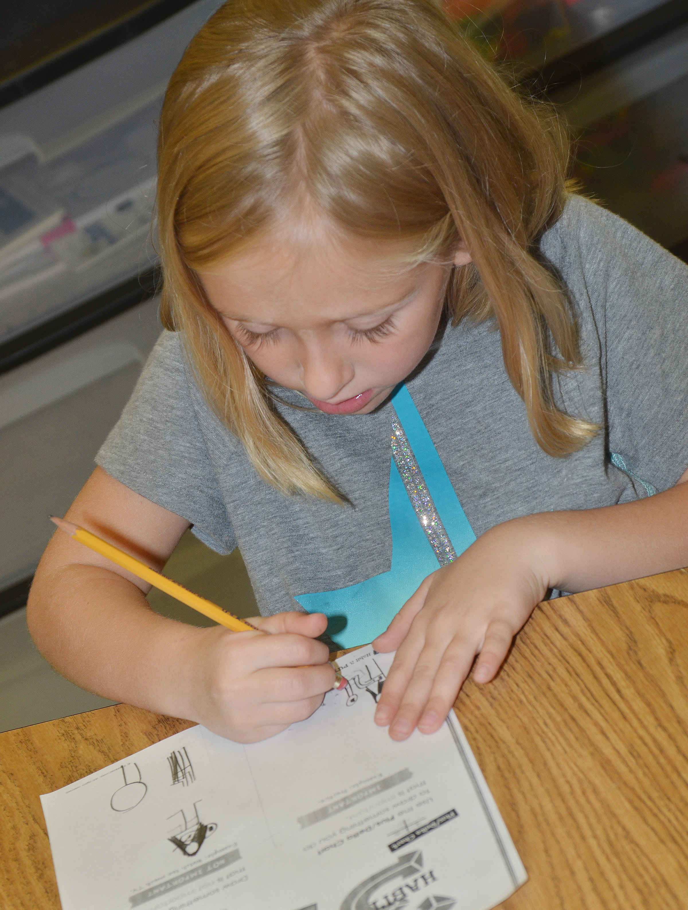 CES first-grader LeeAnna Garvin draws a picture of something that is important.