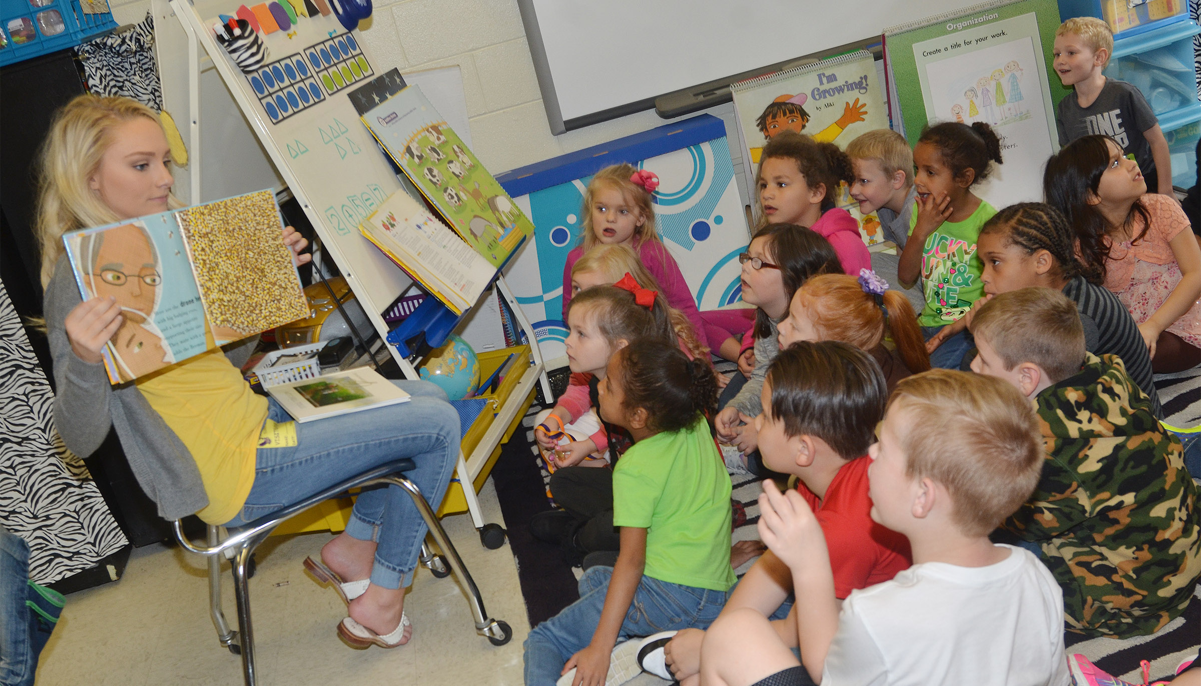 Molly Sullivan, who is Miss Bowling Green Outstanding Teen and will soon compete for the Miss Kentucky Outstanding Teen title, reads to CES kindergarteners about bees.