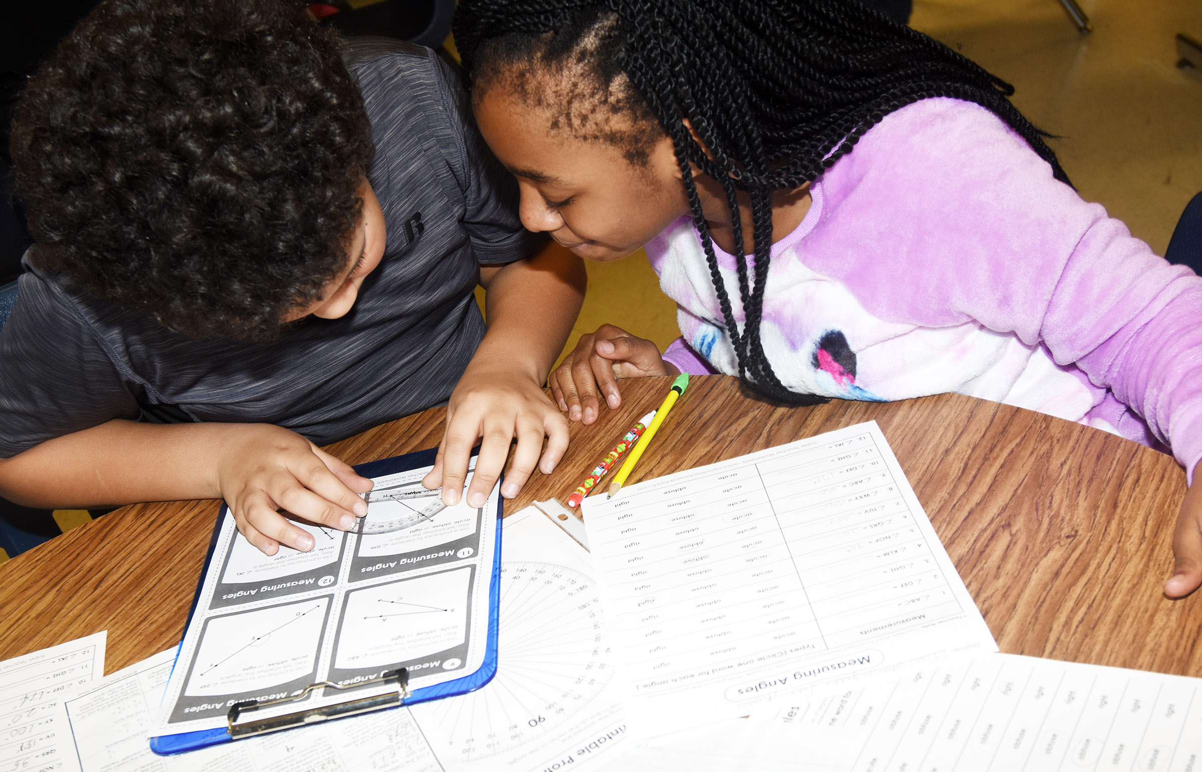 CES fourth-graders Zarek Stone, at left, and Tiffani Gaddie work together to measure an angle.
