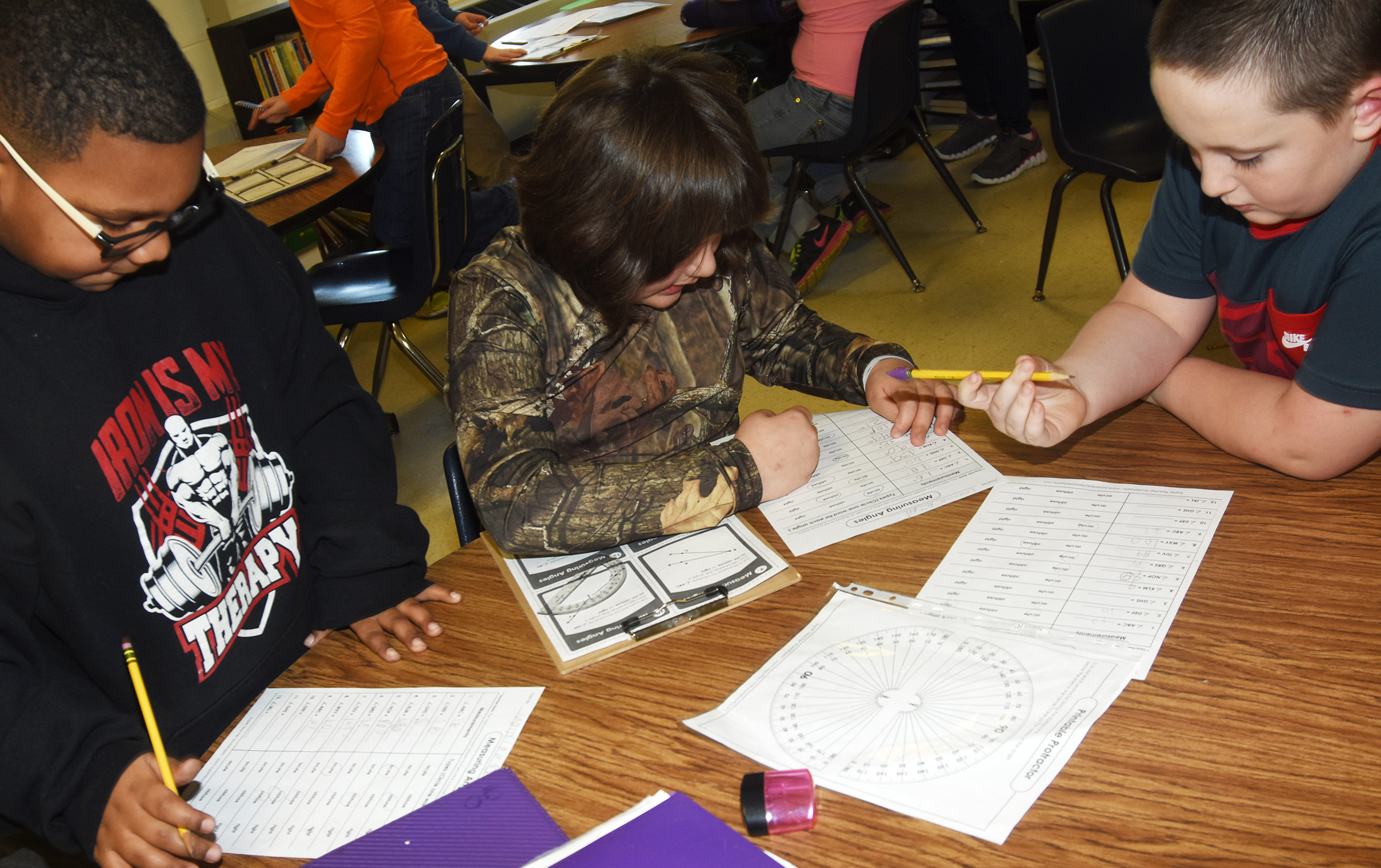 From left, CES fourth-graders Malikiah Spurling, Leanna Puckett and J.J. Scharbrough work together to measure an angle.