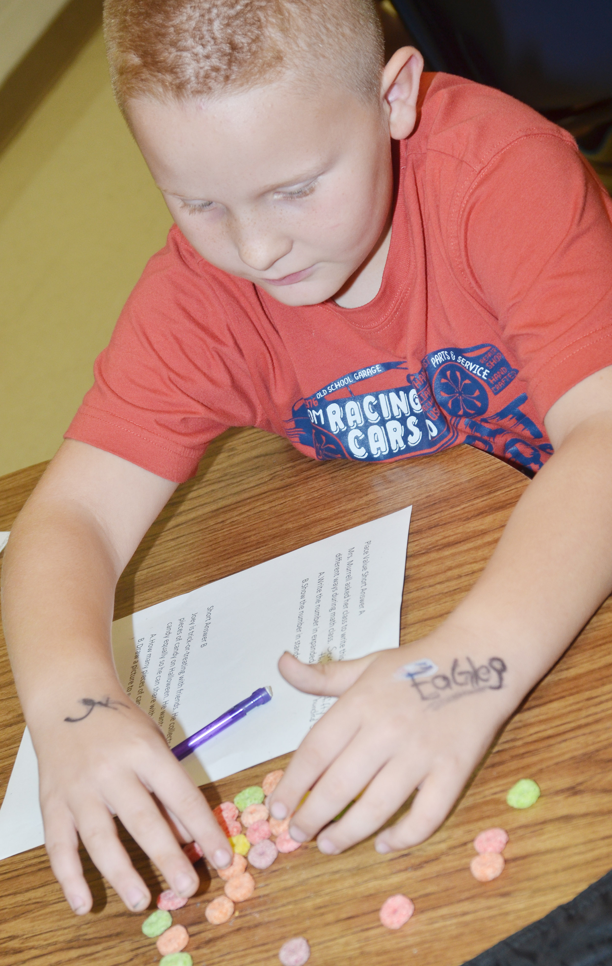CES fourth-grader Isaiah Jeffries counts using pieces of cereal.