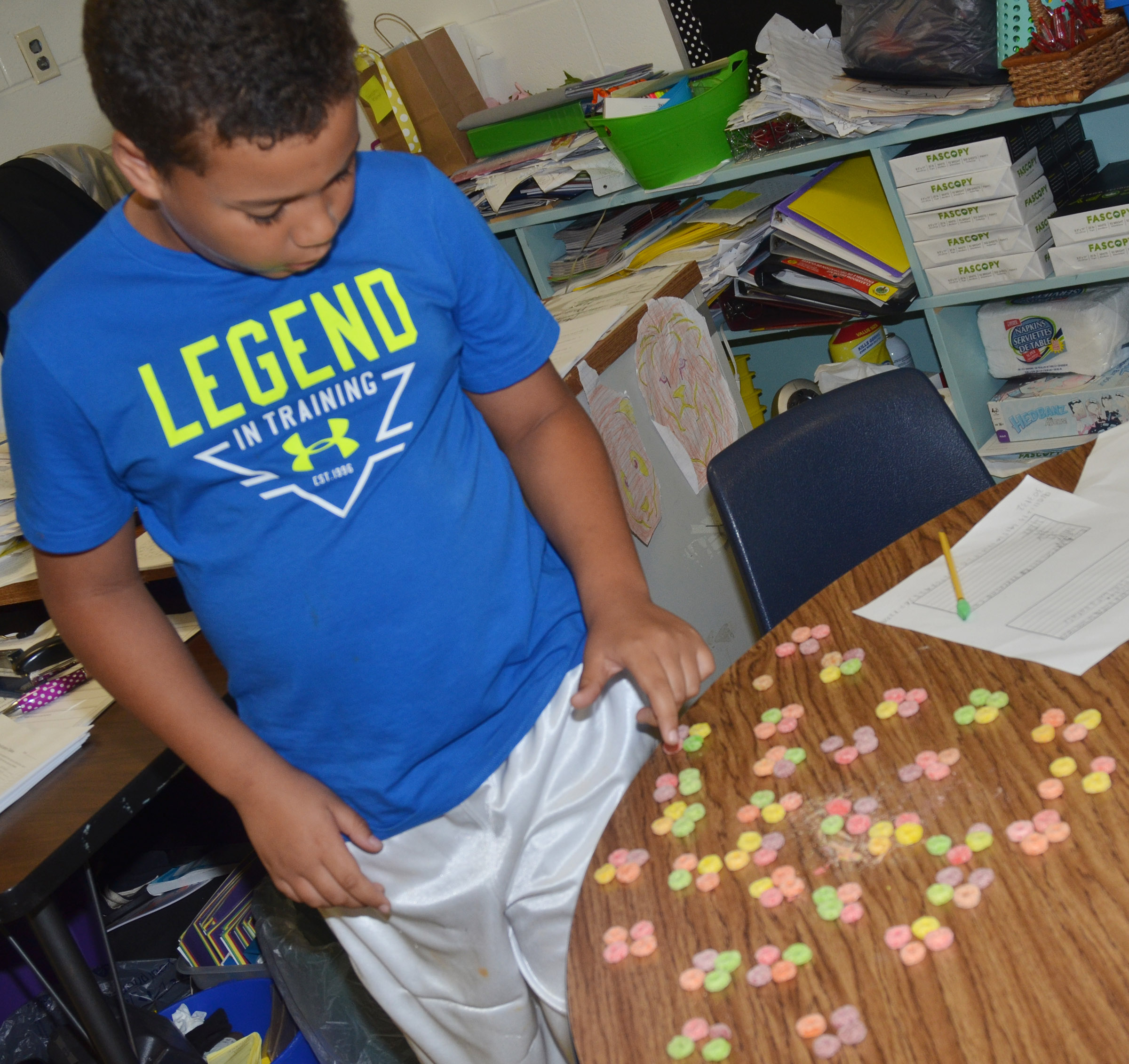 CES fourth-grader Zarek Stone counts using pieces of cereal.