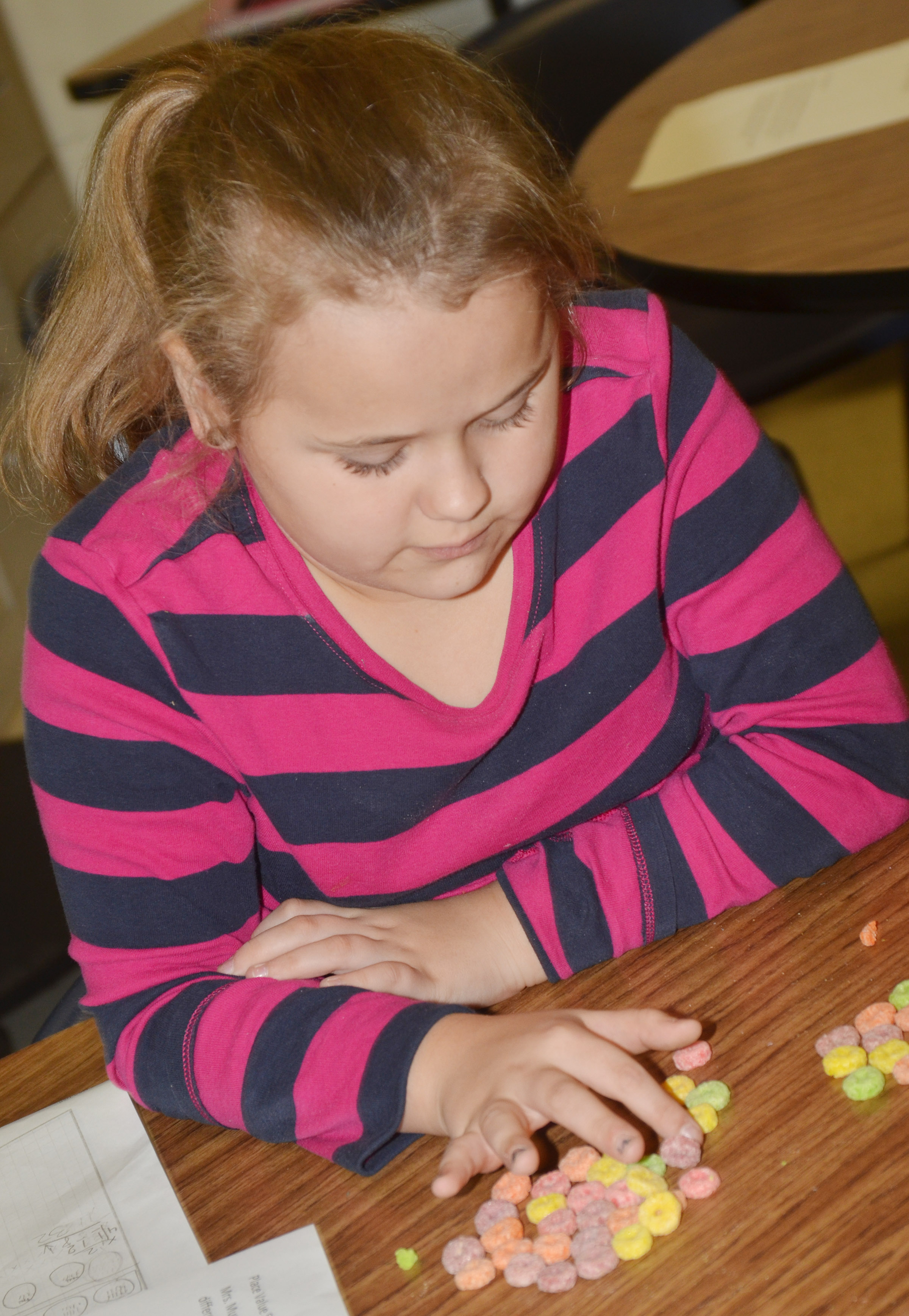 CES fourth-grader Amaya Anguiano counts using pieces of cereal.