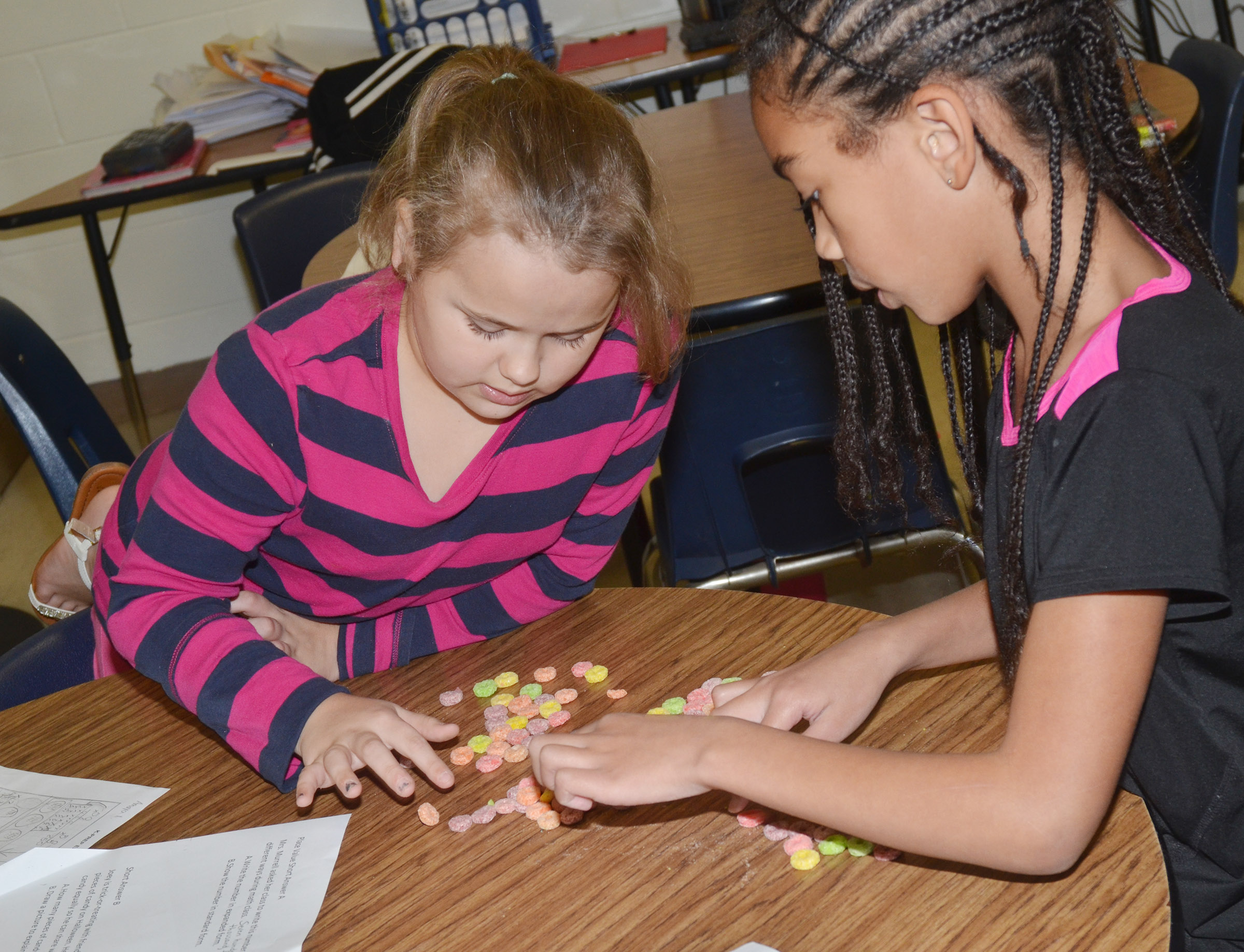 CES fourth-graders Amaya Anguiano, at left, and De'Asia Fisher count using pieces of cereal.