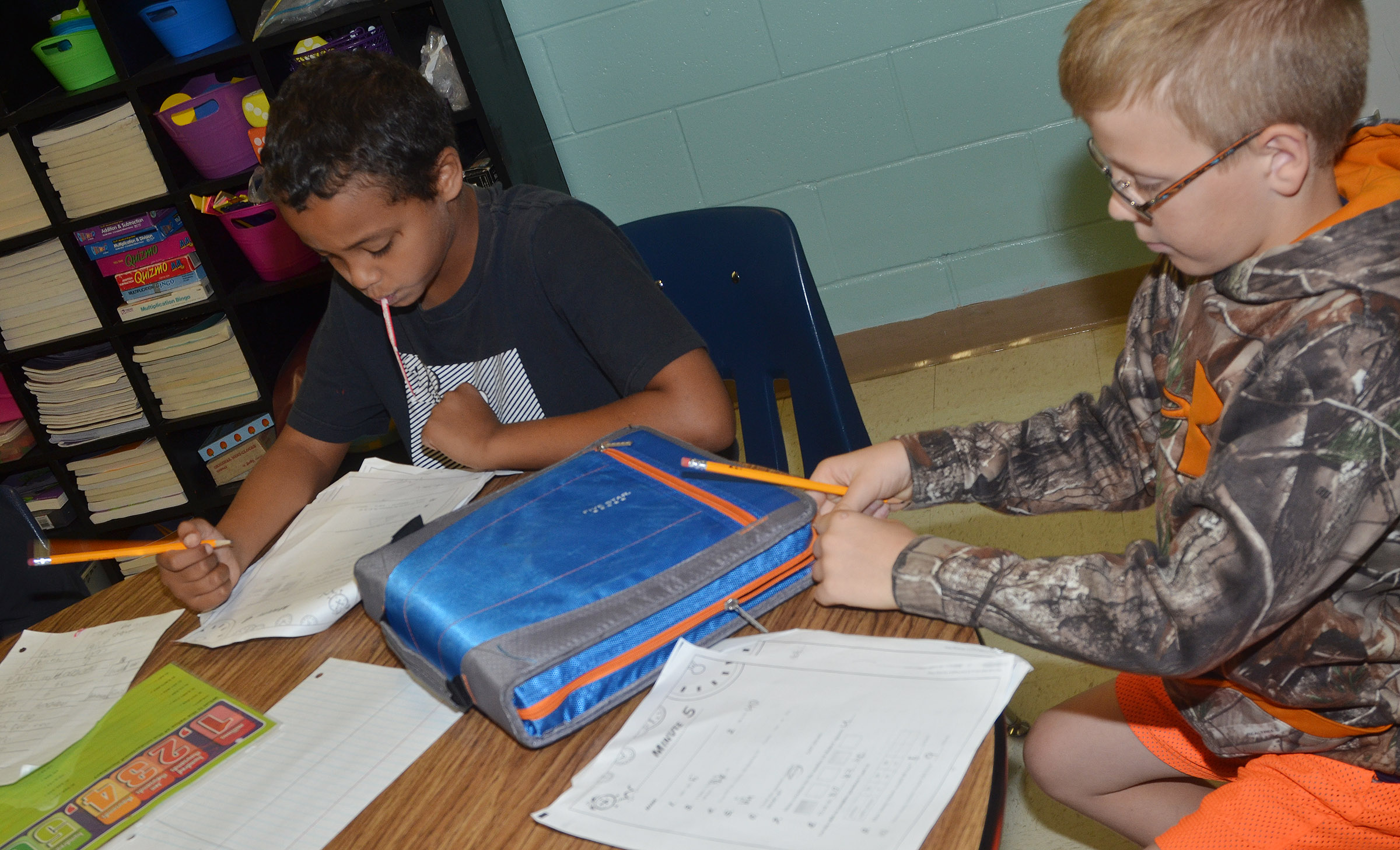 CES fourth-graders Chance Owens, at left, and Ethan Irwin complete their place value worksheets.