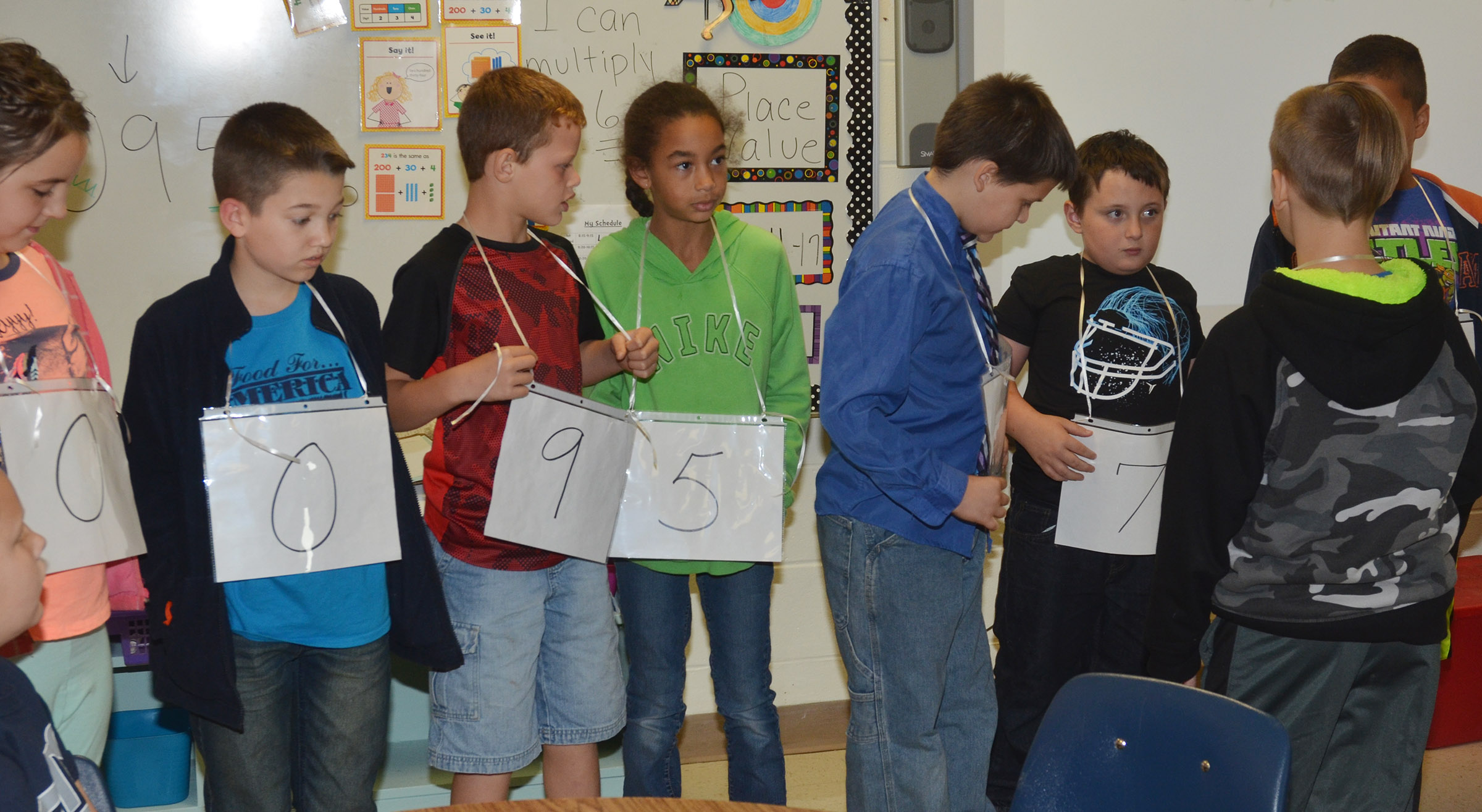 CES fourth-graders work together to form two numbers and then compare the two to see which is greatest.