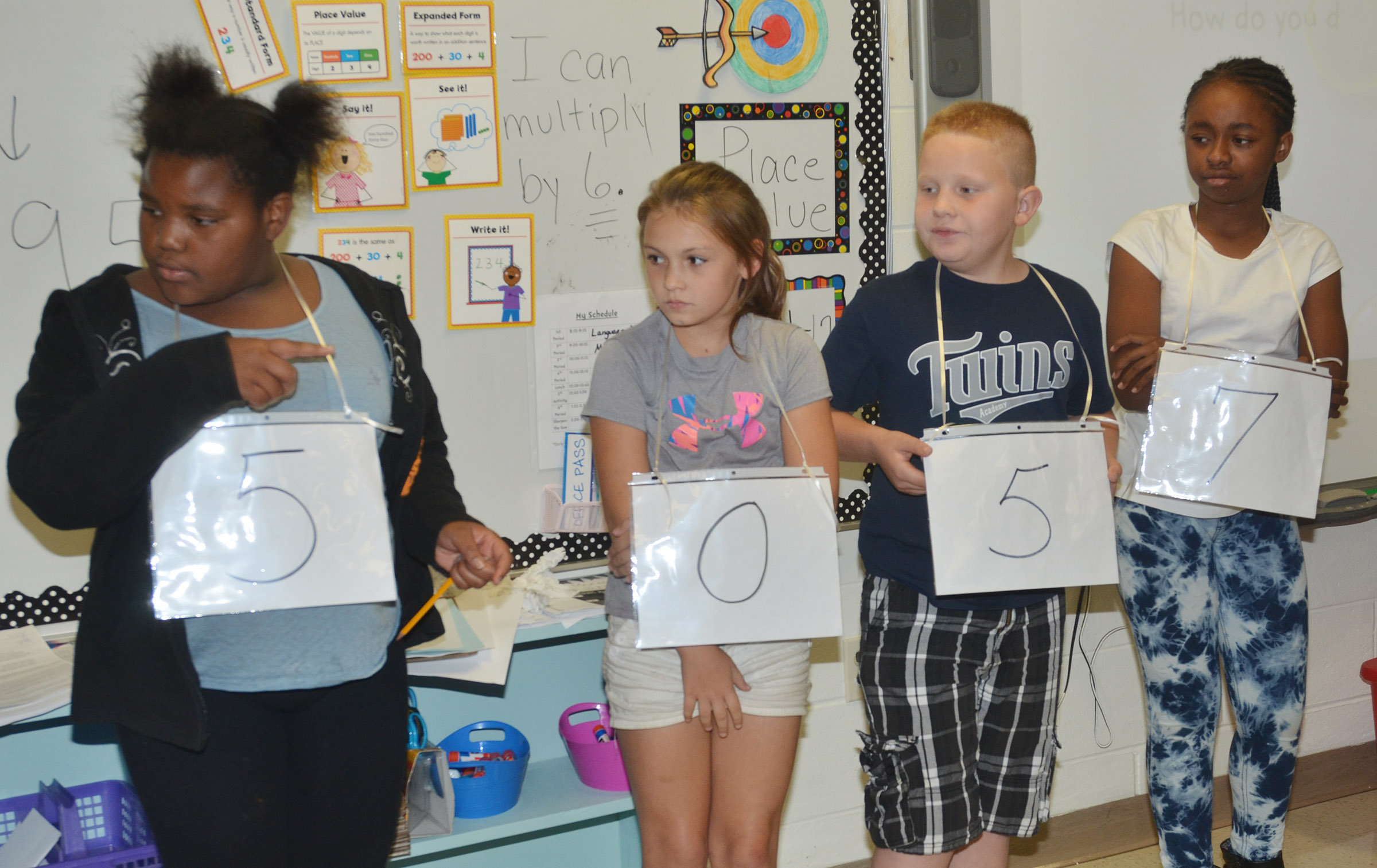 From left, CES fourth-graders Talaysia Daniels, Kealey Mann, Isaiah Jeffries and Tiffani Gaddie form a number to compare.
