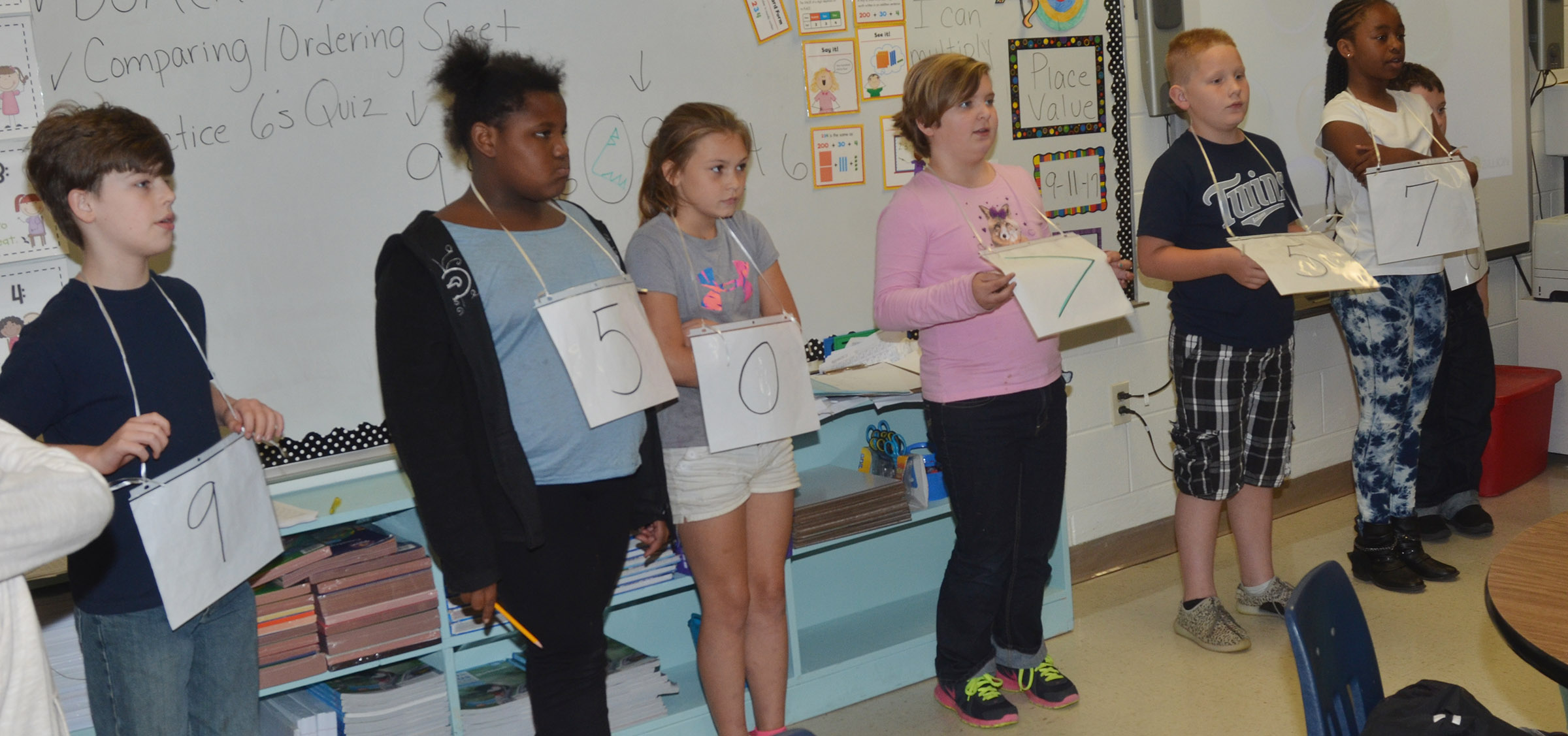 CES fourth-graders work together to form two numbers and them compare the two to see which is greatest.