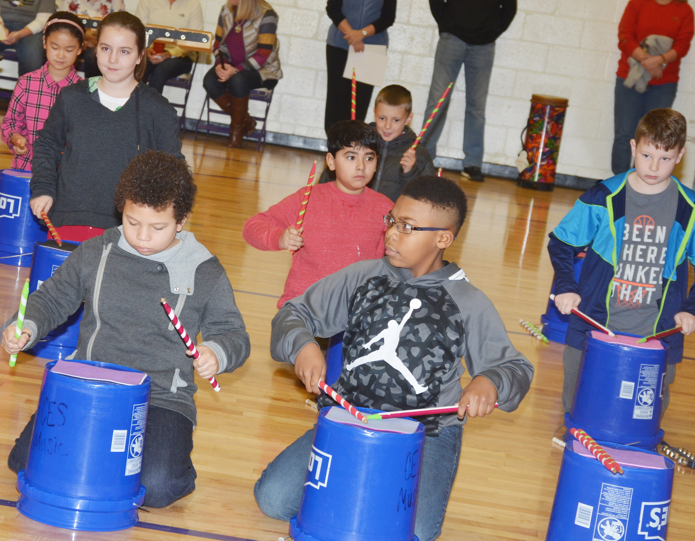 "CES fourth-graders perform ""Run, Run, Rudolph."" In front are Toby Adams, at left, and Austin Sloan. Second row, from left, Alexis Roddy, Cody Tamez and Lucas Gribbins. Back, Demi Hao and Cameron Taylor."