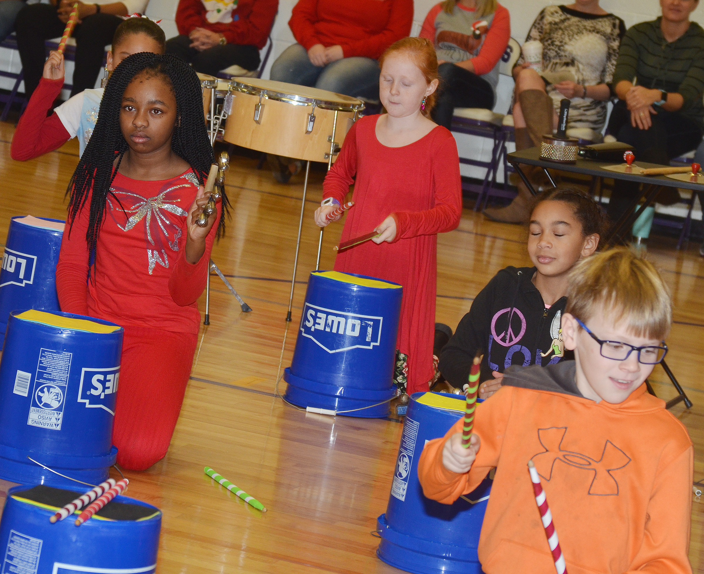 "CES fourth-graders perform ""Run, Run, Rudolph."" From left are Tiffani Gaddie, Nora Harris, De'Asia Fisher and Timothy Coots."