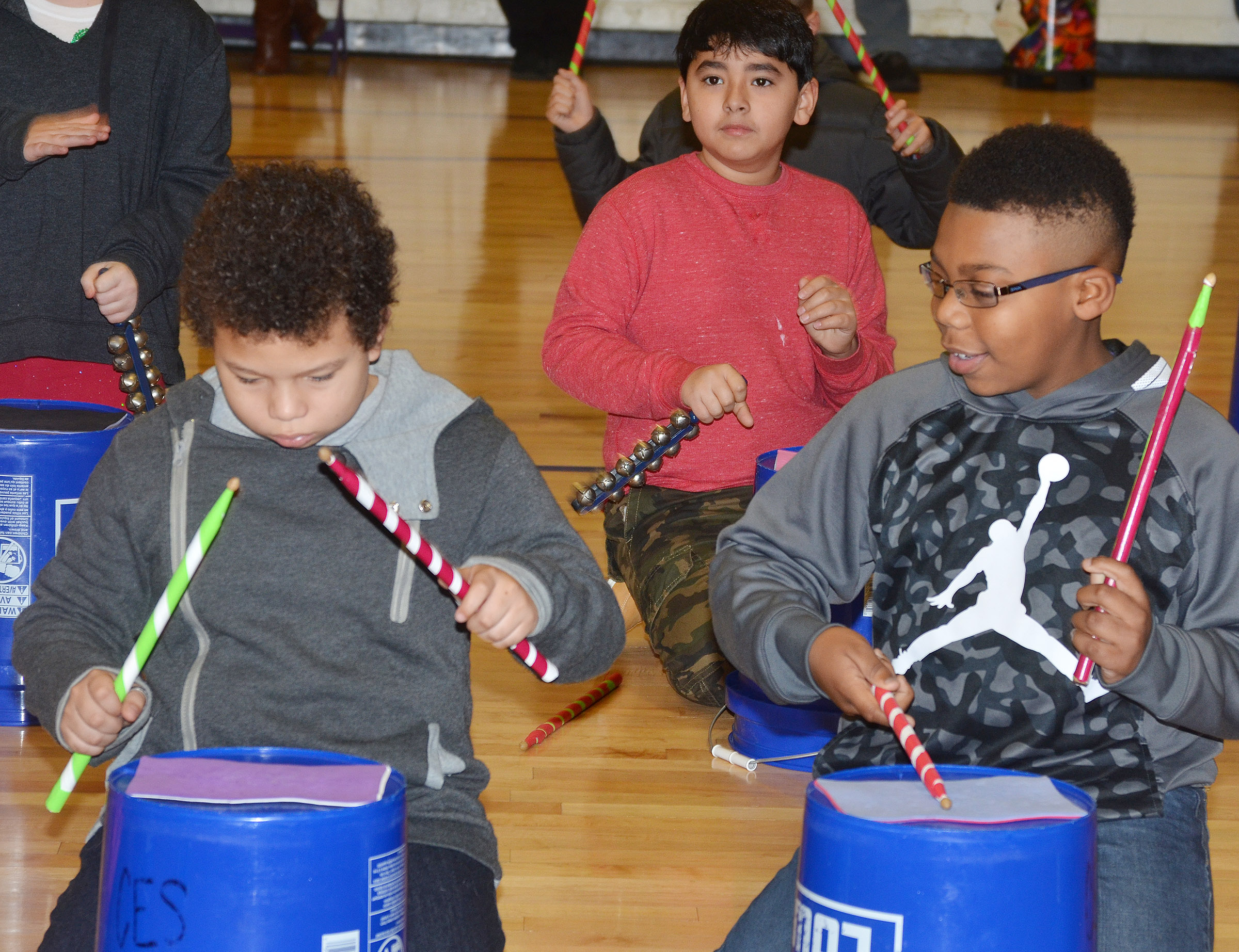 "CES fourth-graders perform ""Run, Run, Rudolph."" From left are Toby Adams, Cody Tamez and Austin Sloan."